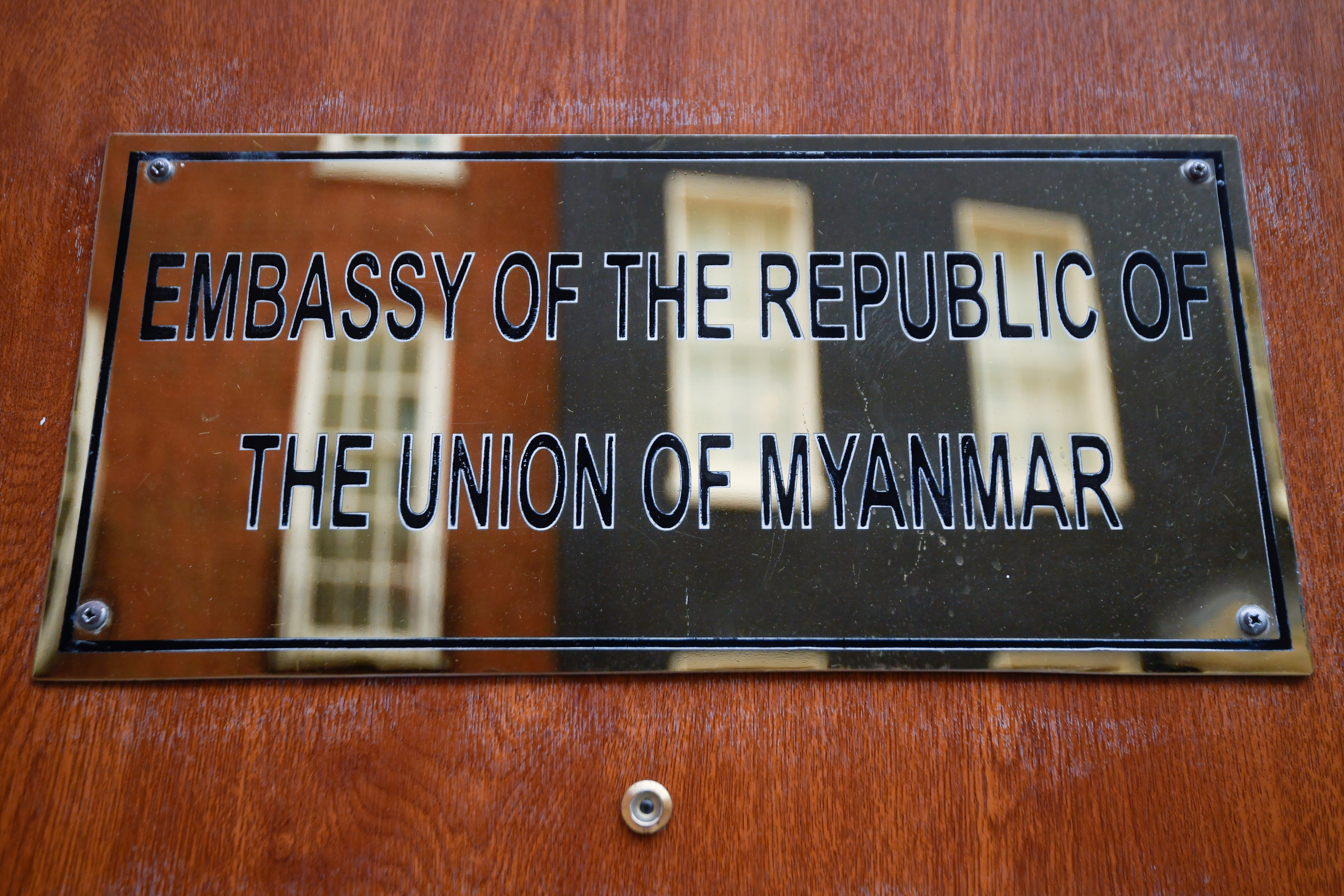 A placard of the Myanmar Embassy is seen on its' door in London, Britain, April 8, 2021. REUTERS/Toby Melville