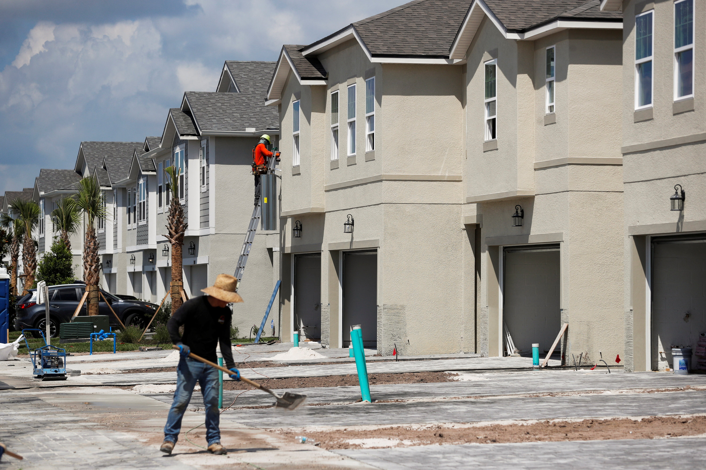 A carpenter works on building new townhomes that are still under construction while building material supplies are in high demand in Tampa, Florida, U.S., May 5, 2021.  REUTERS/Octavio Jones