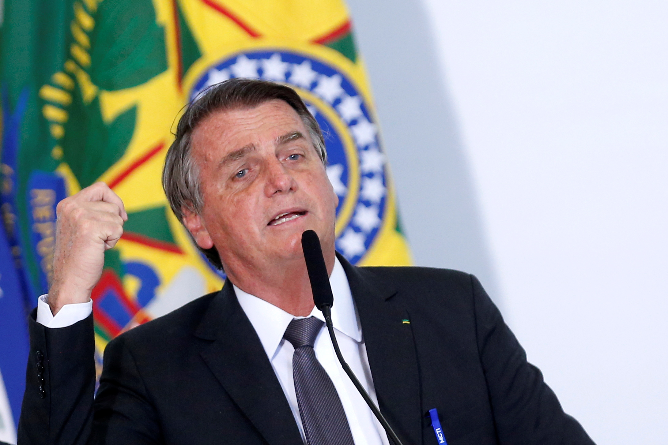 Brazil's President Jair Bolsonaro speaks during a ceremony to sign a law for the privatization of state-controlled electricity utility Eletrobras, at the Planalto Palace in Brasilia, Brazil, July 13, 2021. REUTERS/Adriano Machado