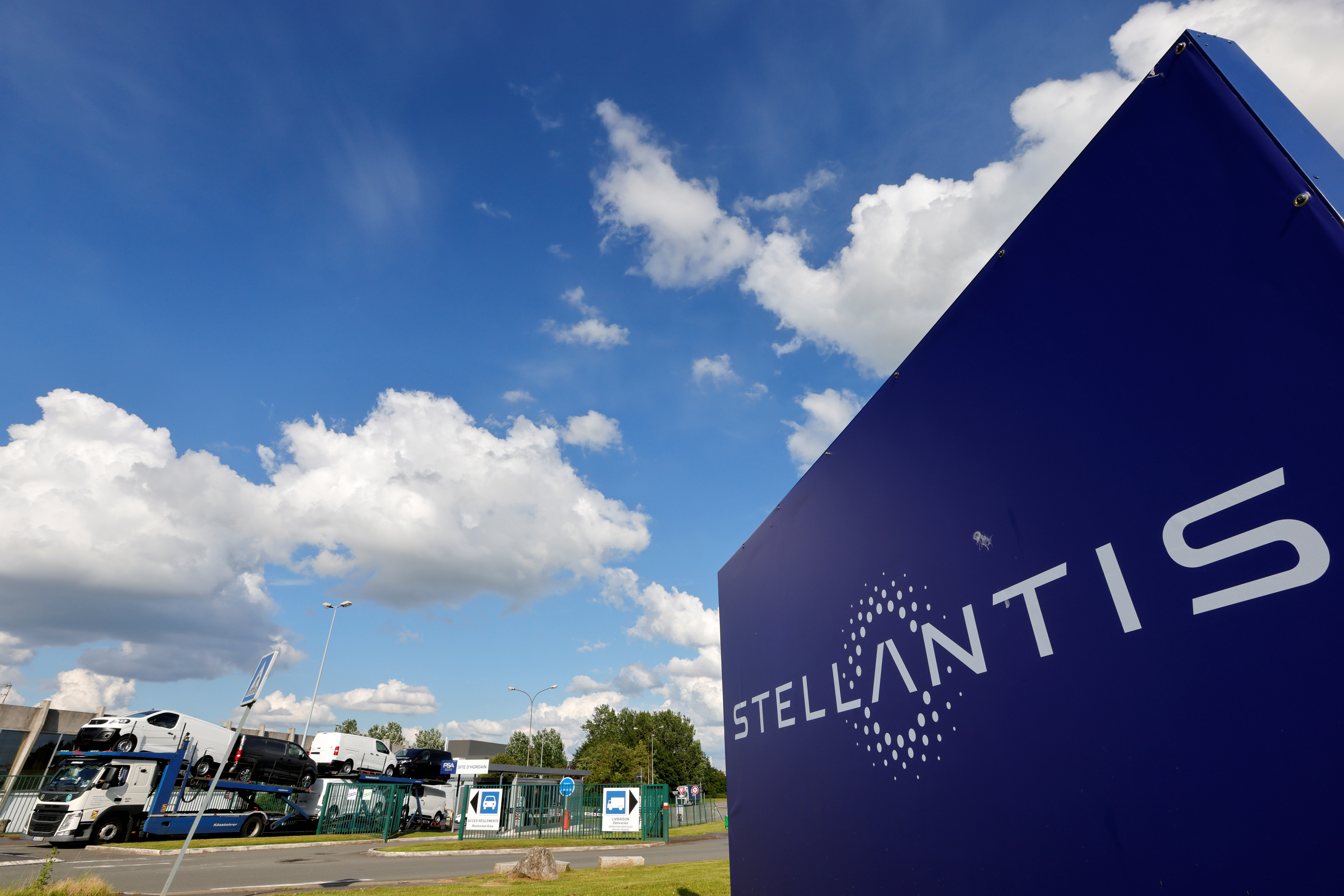 A view shows the logo of Stellantis at the entrance of the company's factory in Hordain, France, July 7, 2021. REUTERS/Pascal Rossignol