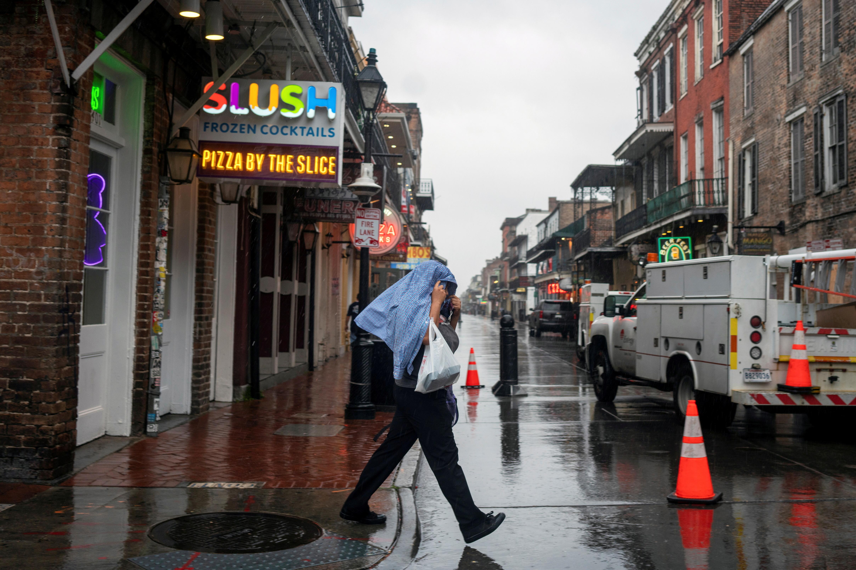 A man crosses a street as Hurricane Zeta approaches New Orleans, Louisiana, U.S. October 28, 2020.  REUTERS/Kathleen Flynn/File Photo