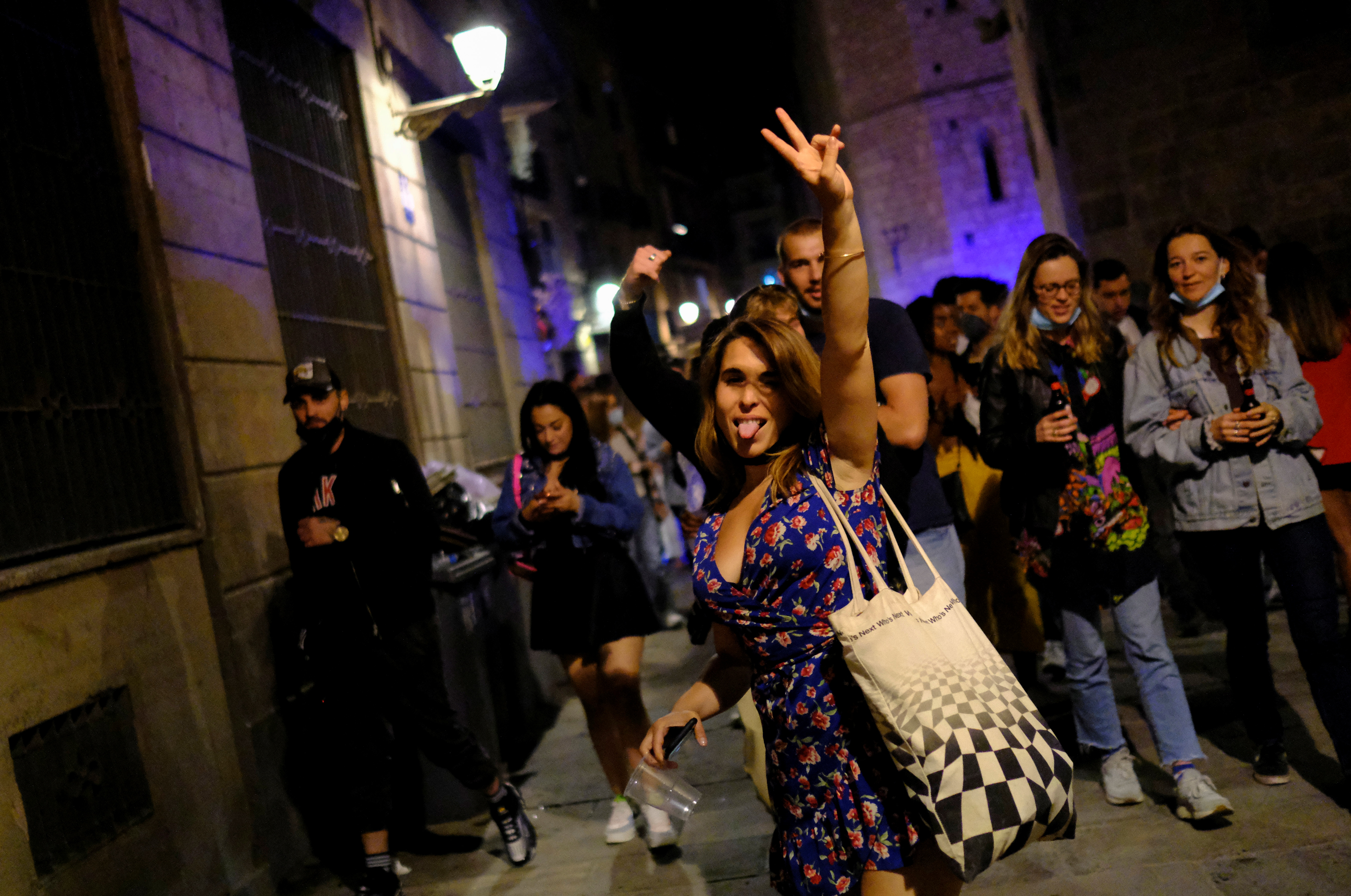 People celebrate on a street in the neighborhood of Born, as the state of emergency decreed by the Spanish Government to prevent the spread of the coronavirus disease (COVID-19) gets lifted in Barcelona, Spain, May 9, 2021. REUTERS/Nacho Doce