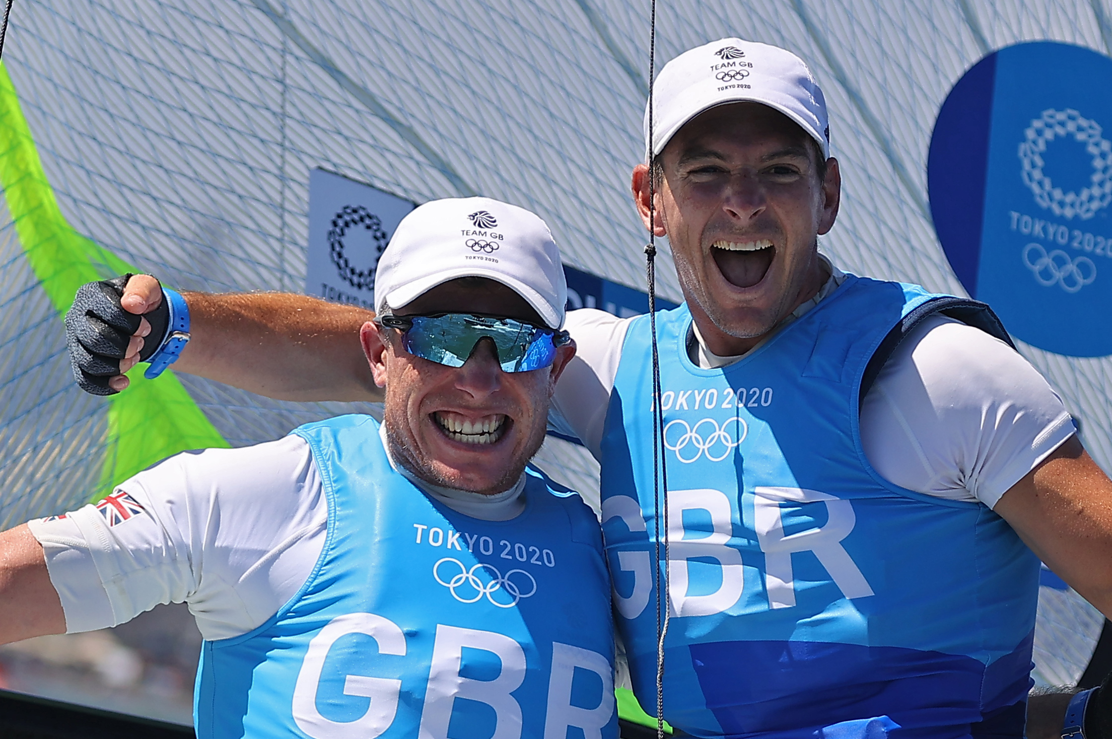 Tokyo 2020 Olympics - Sailing - Men's 49er - Medal Race - Enoshima Yacht Harbour - Tokyo, Japan - August 3, 2021. Dylan Fletcher of Britain and Stuart Bithell of Britain celebrate winning gold after the race. REUTERS/Carlos Barria