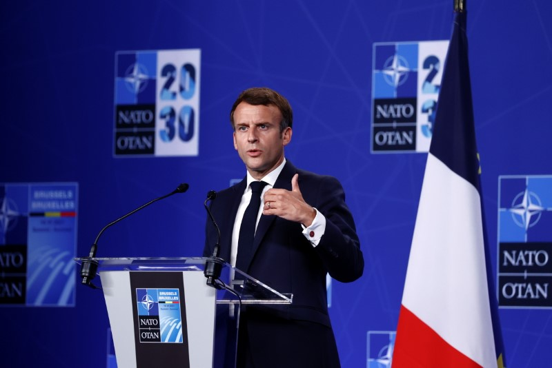 France's President Emmanuel Macron holds a news conference during the NATO summit in Brussels, Belgium June 14, 2021. REUTERS/Christian Hartmann