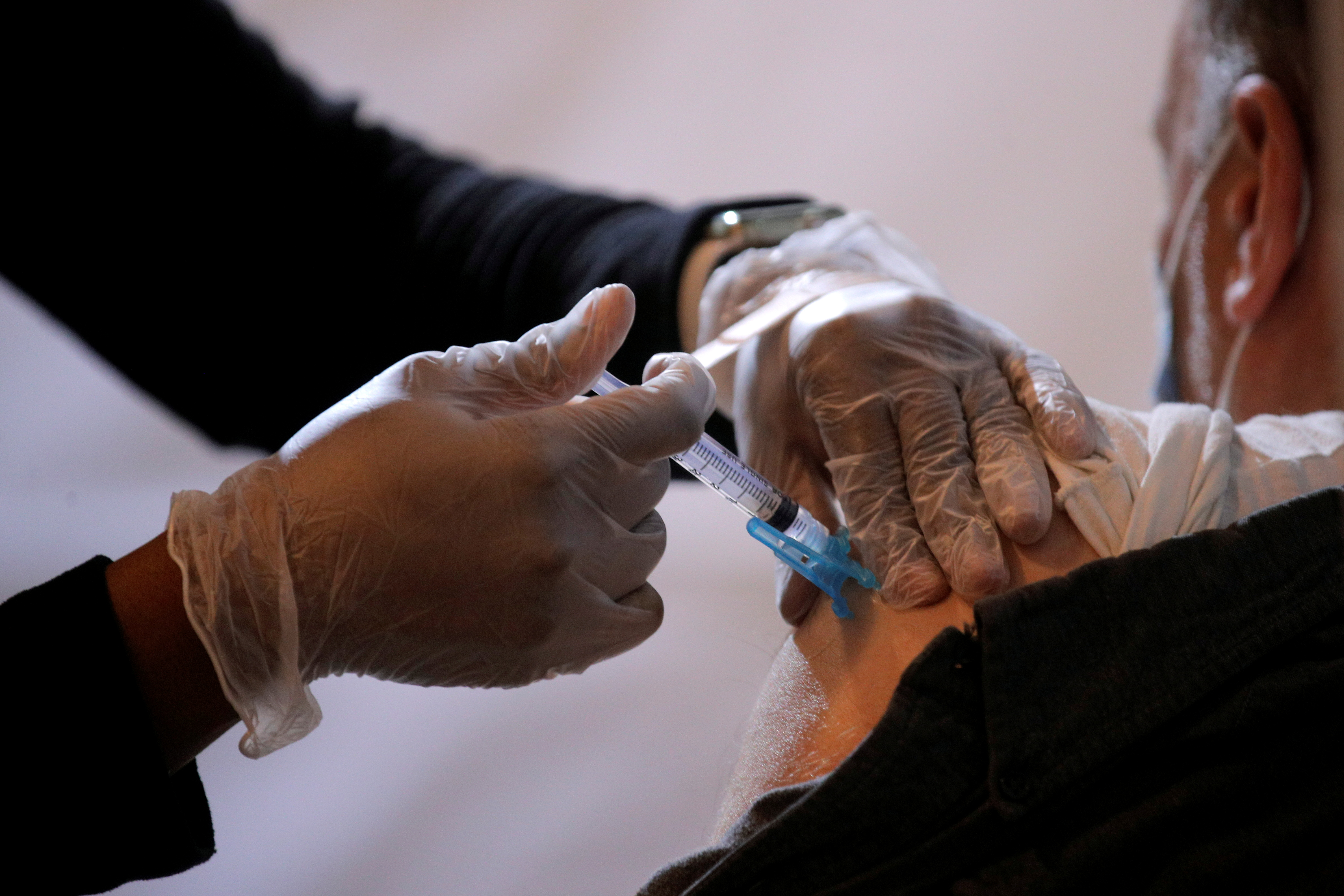A commuter receives a shot of the Johnson & Johnson vaccine for the coronavirus disease (COVID-19) during the opening of MTA's public vaccination program at a subway station in the Brooklyn borough of New York City, New York, U.S., May 12, 2021. REUTERS/Brendan McDermid