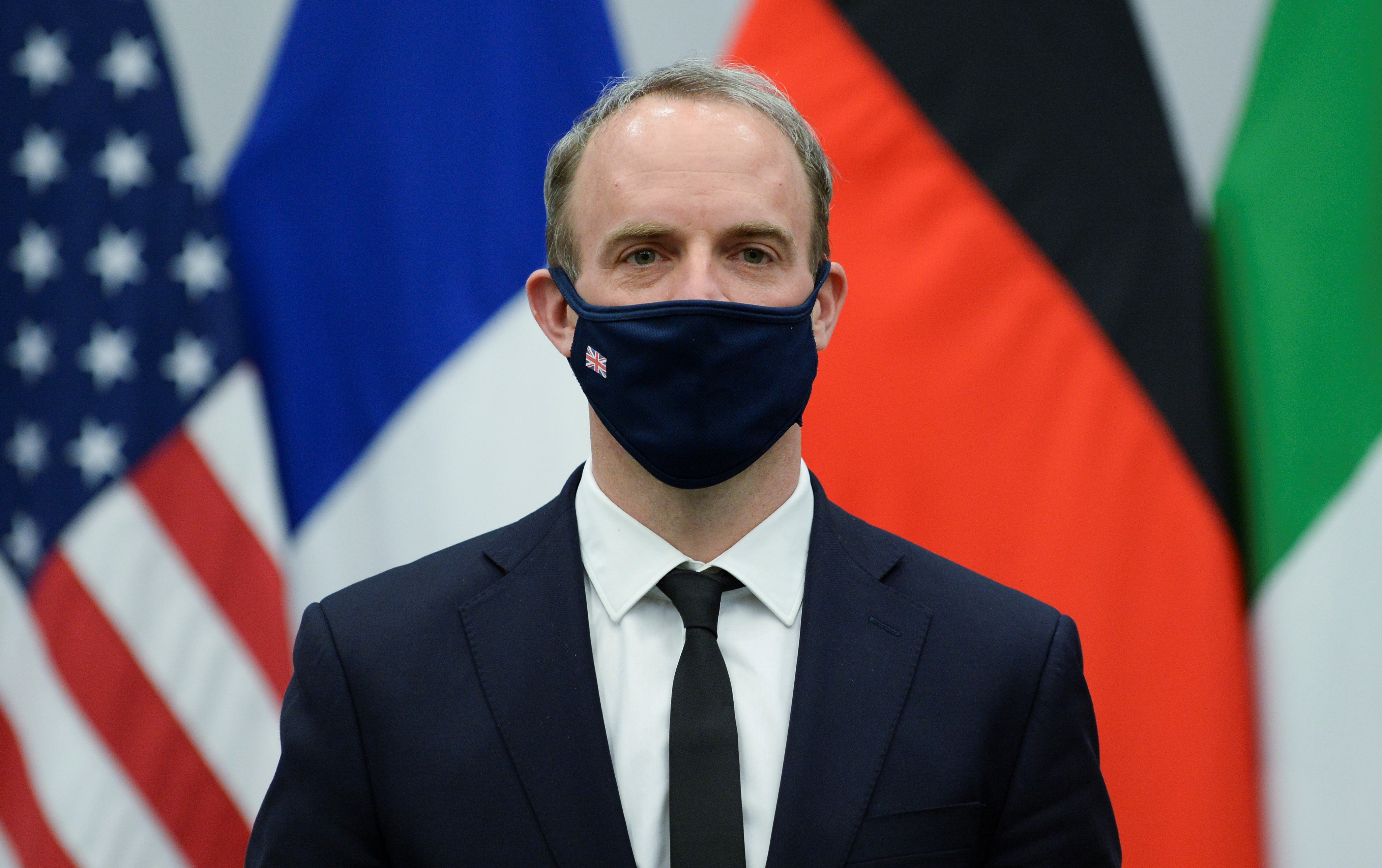 Britain's Foreign Secretary Dominic Raab wears a protective mask during a meeting with U.S. Secretary of State Antony Blinken in Brussels, Belgium April 14, 2021. REUTERS/Johanna Geron/Pool