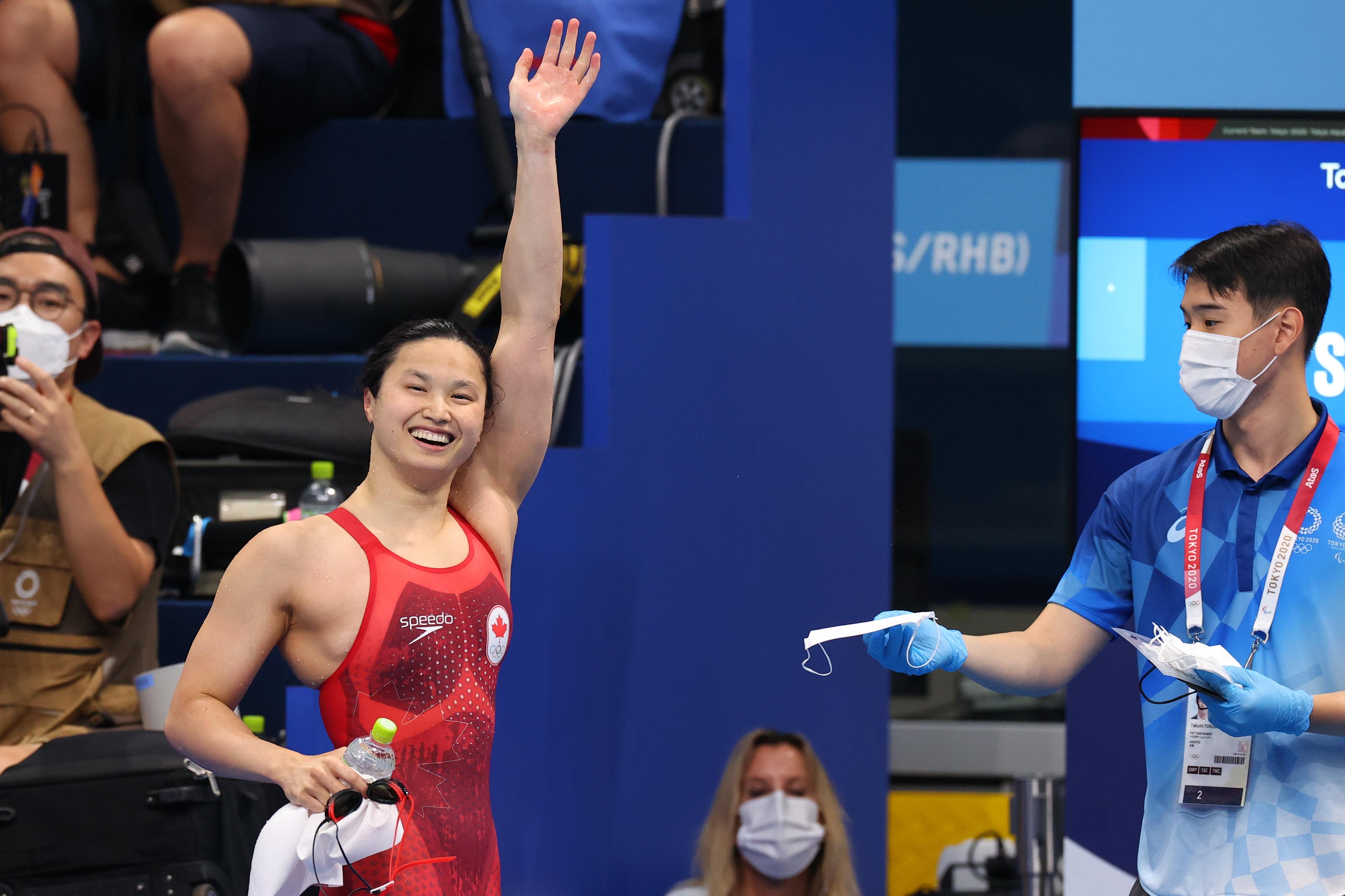 Tokyo 2020 Olympics - Swimming - Women's 100m Butterfly - Final - Tokyo Aquatics Centre - Tokyo, Japan - July 26, 2021. Margaret MacNeil of Canada celebrates after winning the gold medal REUTERS/Marko Djurica