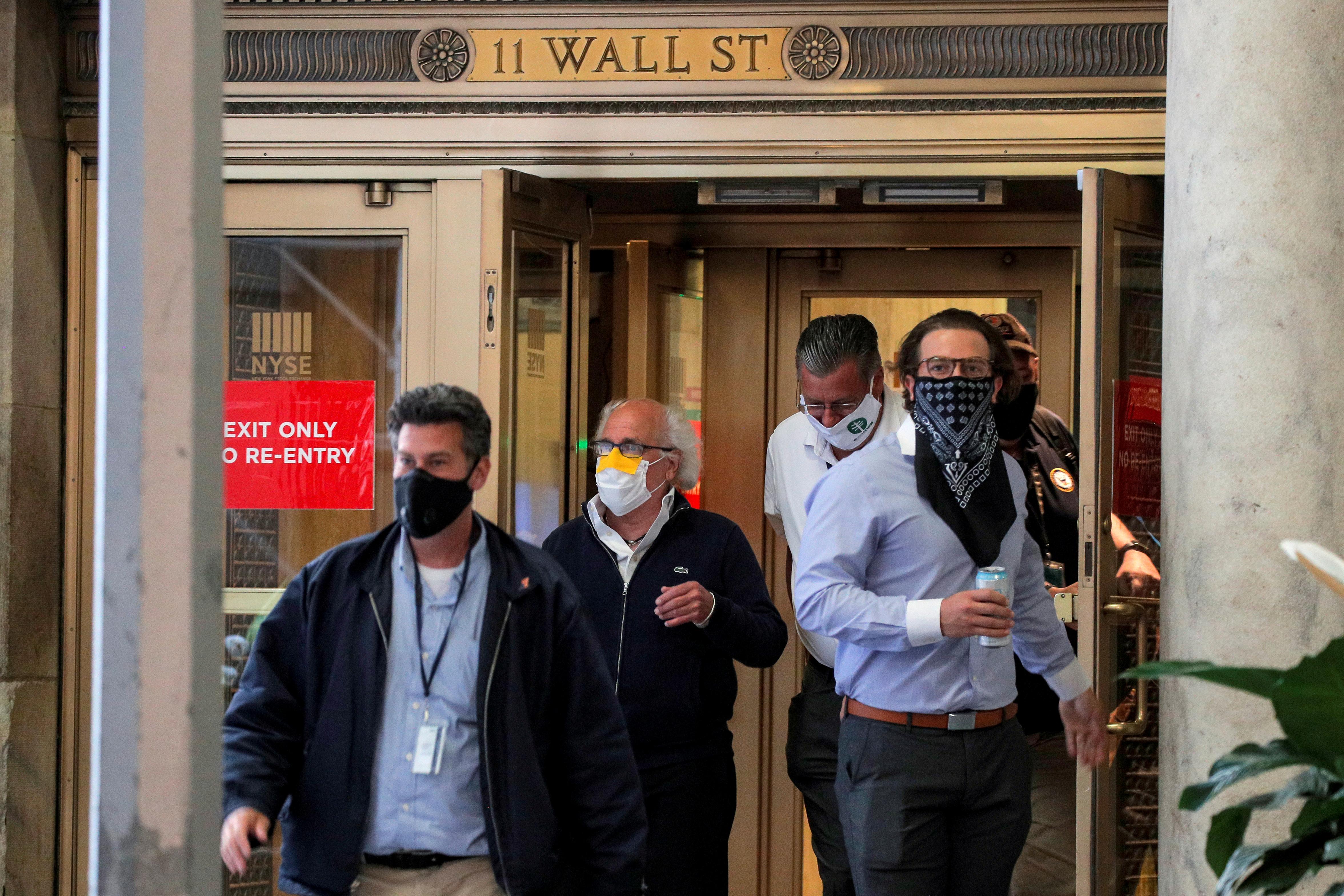 Traders exit the 11 Wall St. door of the New York Stock Exchange (NYSE) in New York City, New York, U.S., June 26, 2020. REUTERS/Brendan McDermid