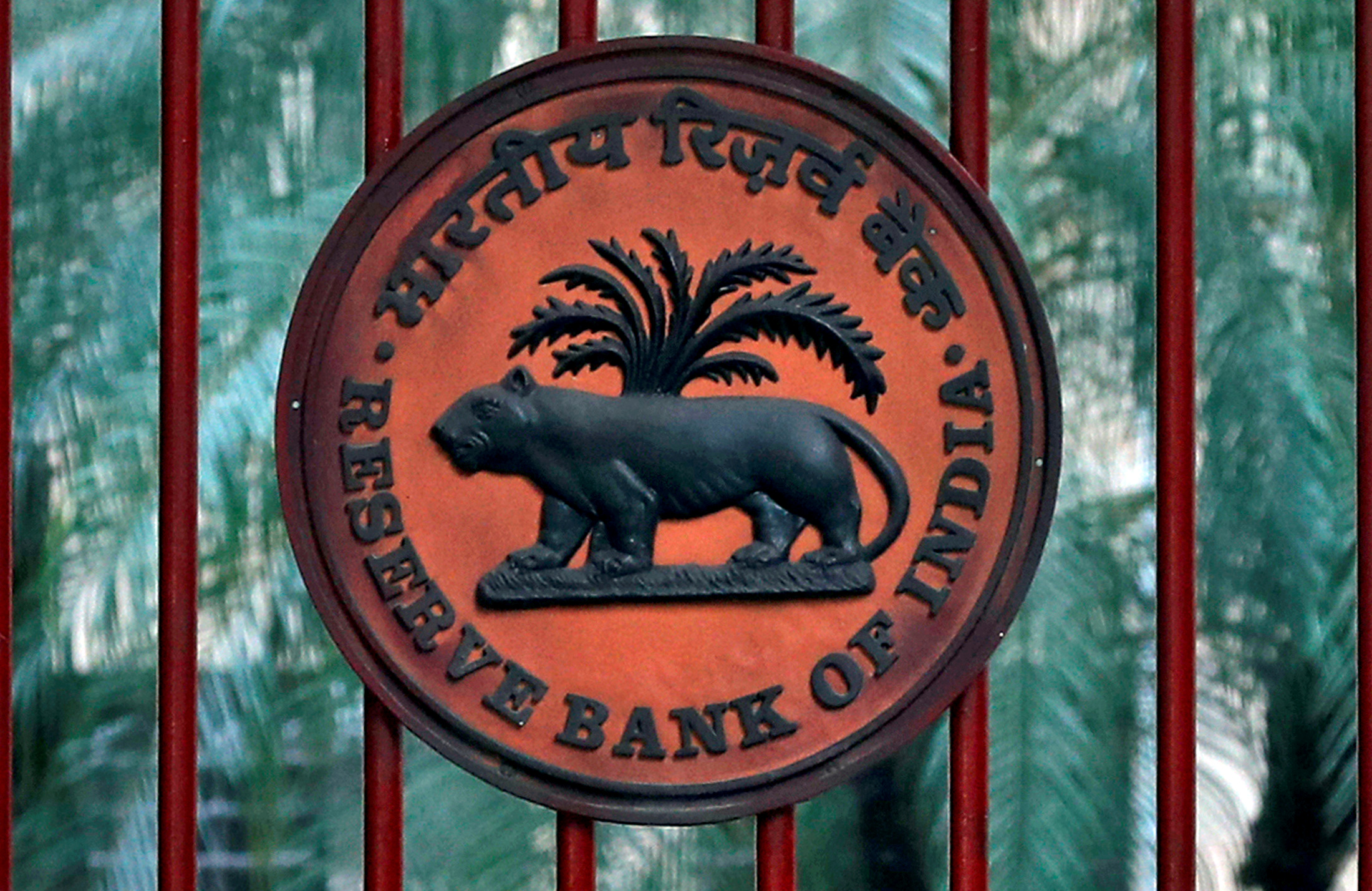 FILE PHOTO: A Reserve Bank of India (RBI) logo is seen at the gate of its office in New Delhi, India, November 9, 2018. REUTERS/Altaf Hussain/File Photo