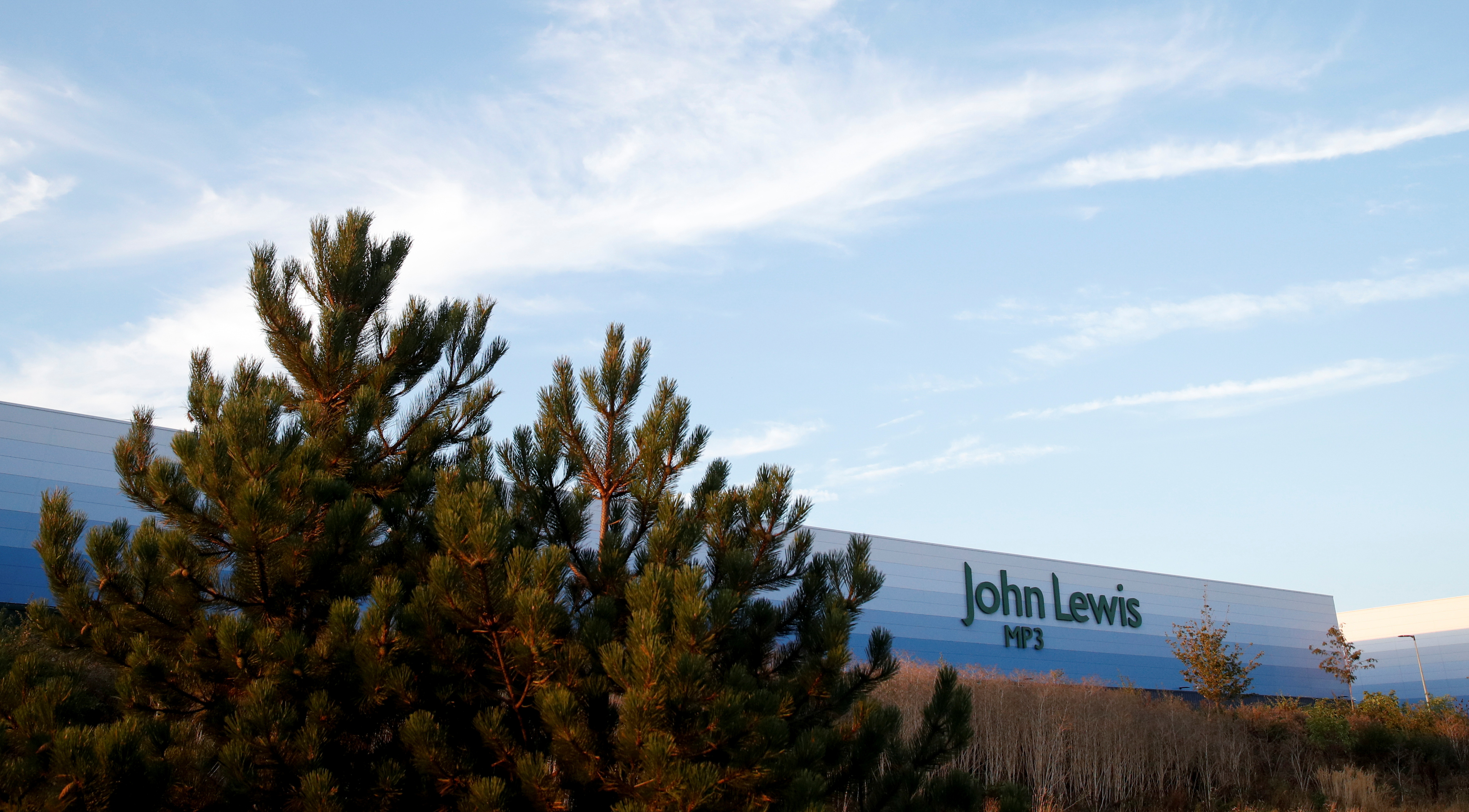 A John Lewis warehouse is pictured at Magna Park in Milton Keynes, Britain, September 26, 2021. REUTERS/Andrew Boyers