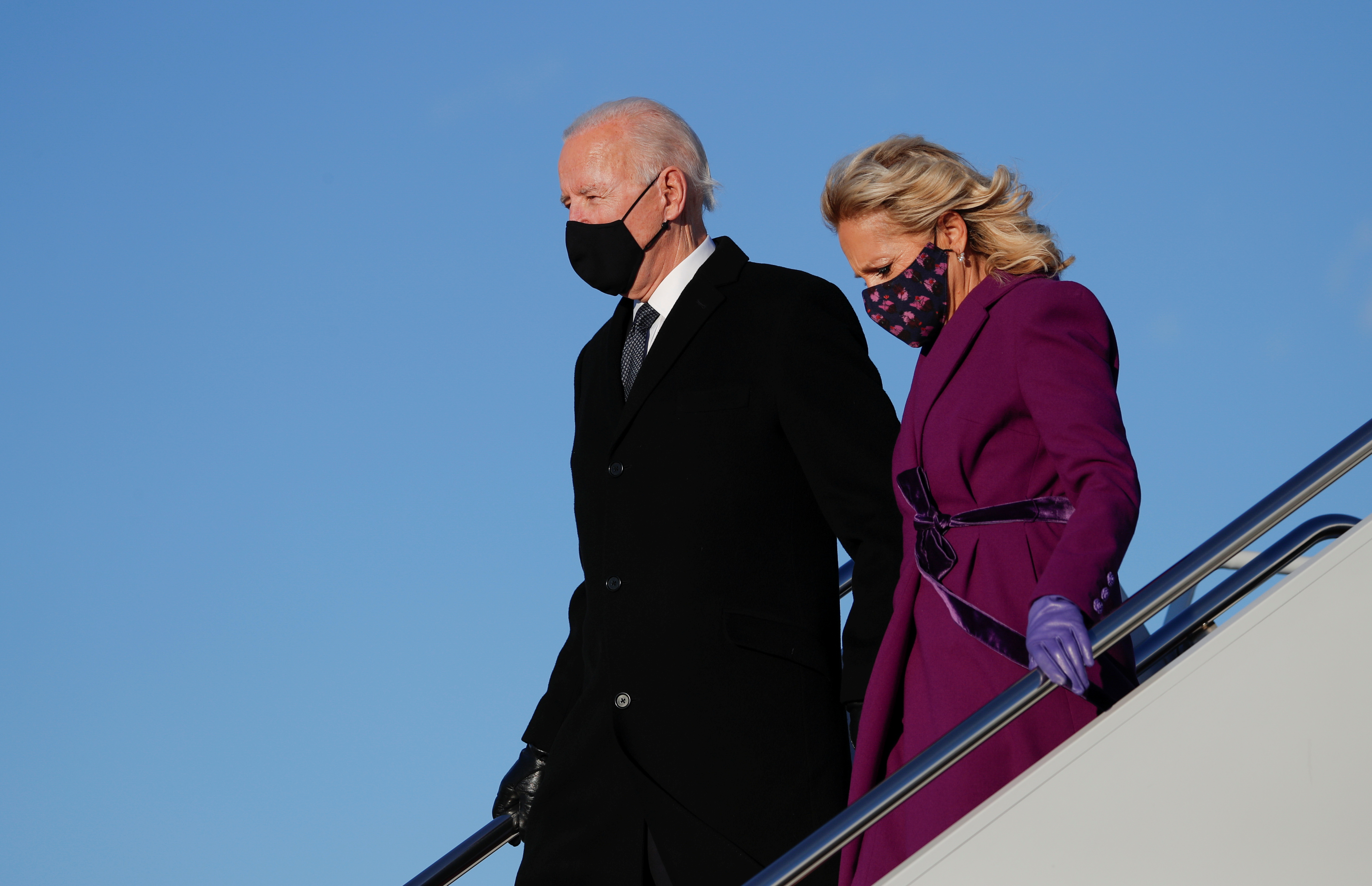 U.S. President-elect Joe Biden and his wife Jill disembark a plane at Joint Base Andrews in Maryland, U.S. January 19, 2021. REUTERS/Tom Brenner