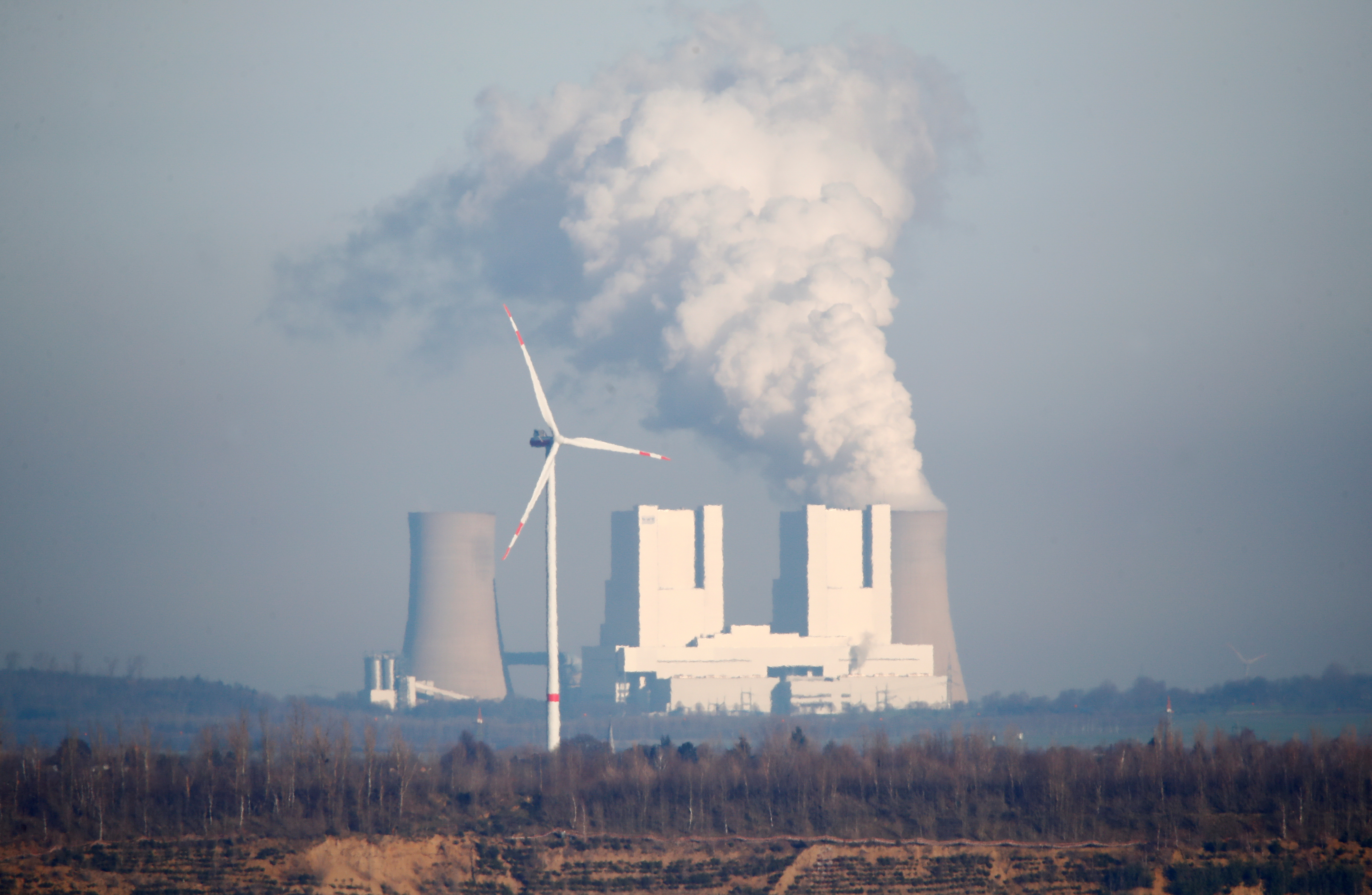 Steam rises from Neurath lignite power plant, in Grevenbroich, Germany, January 16, 2020. REUTERS/Wolfgang Rattay