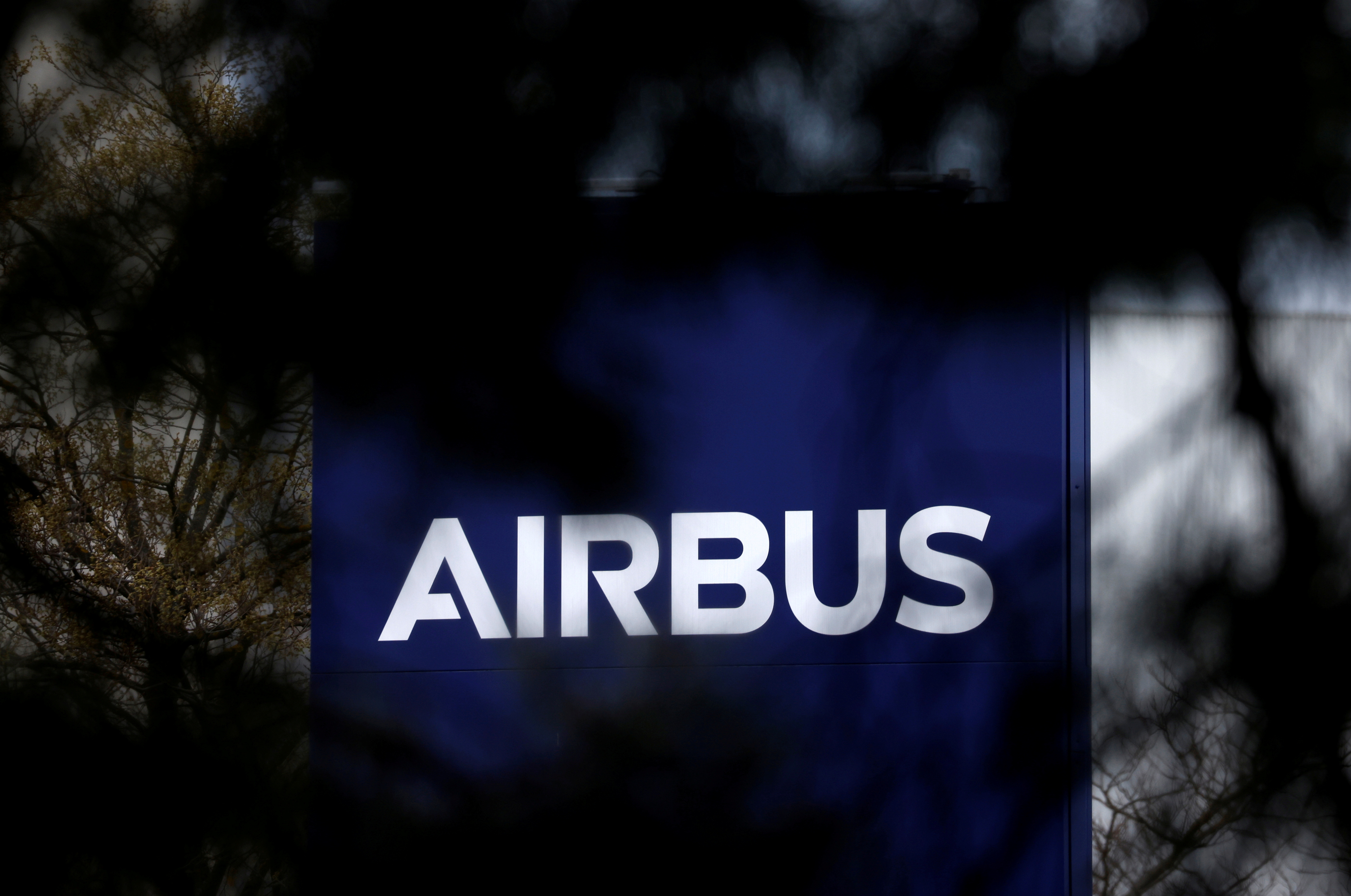 The logo of Airbus is seen at the entrance of a building in Toulouse, France, March 11, 2021. REUTERS/Stephane Mahe/File Photo