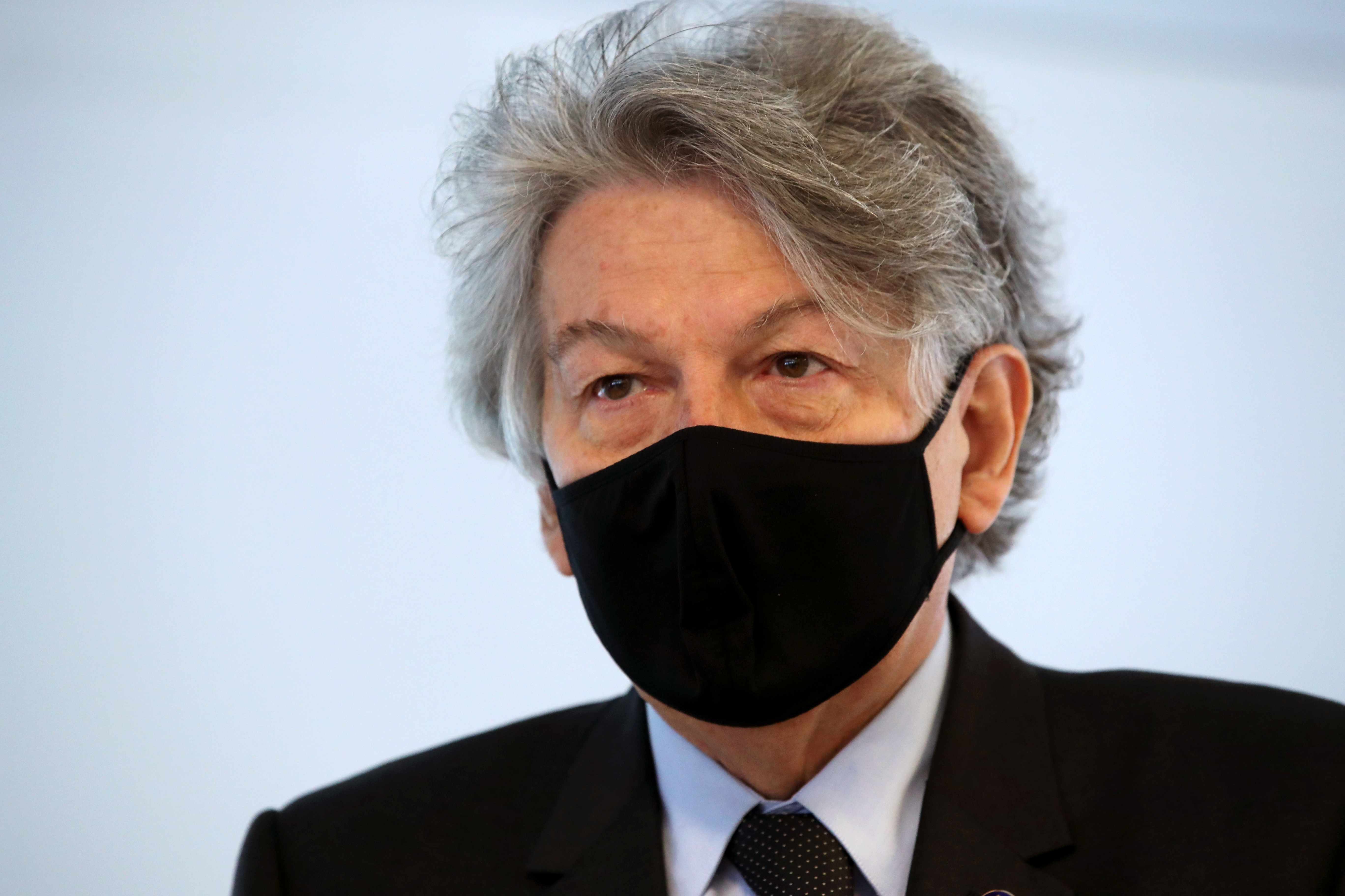 European Industry Commissioner Thierry Breton, wearing a protective face mask, attends a presentation before a visit at the Thermo Fisher plant, former Novasep, producing COVID-19 vaccines for AstraZeneca in Seneffe, Belgium, February 10, 2021.  REUTERS/Yves Herman