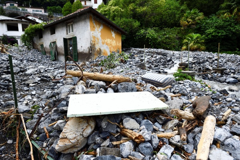 A house hit by a landslide is seen after heavy rain caused flooding in towns surrounding Lake Como in northern Italy, in Laglio, Italy, July 27, 2021. REUTERS/Flavio Lo Scalzo
