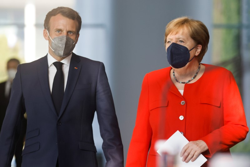 German Chancellor Angela Merkel and French President Emmanuel Macron arrive to give a news statement in Berlin, Germany, June 18, 2021. REUTERS/Axel Schmidt/Pool