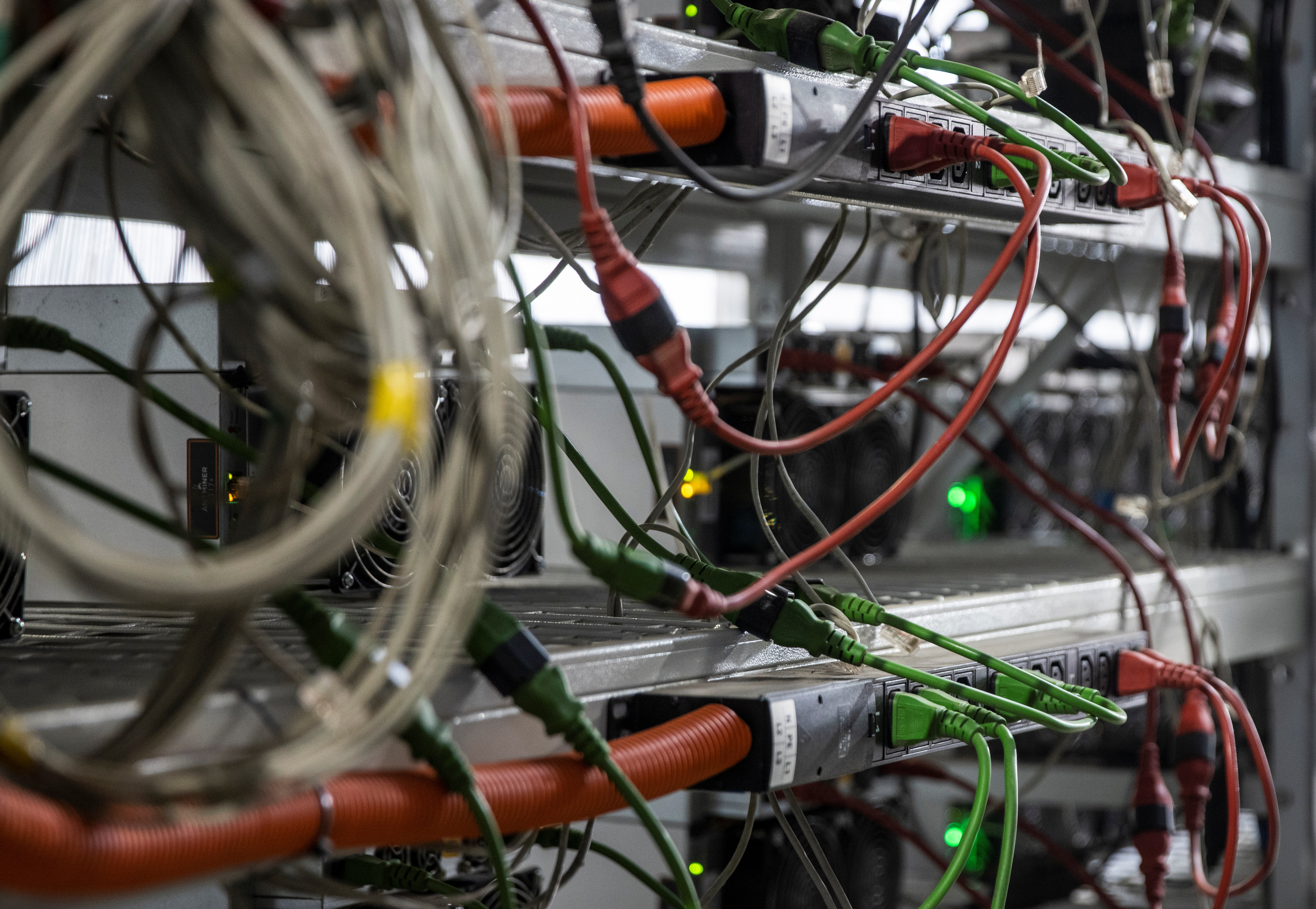 A view shows equipment at the data centre of BitRiver company providing services for cryptocurrency mining in the city of Bratsk in Irkutsk Region, Russia March 2, 2021. BitRiver offers hosting services and turnkey solutions for cryptocurrency mining operations to institutional investors including bitcoin mining firms. Picture taken March 2, 2021. REUTERS/Maxim Shemetov