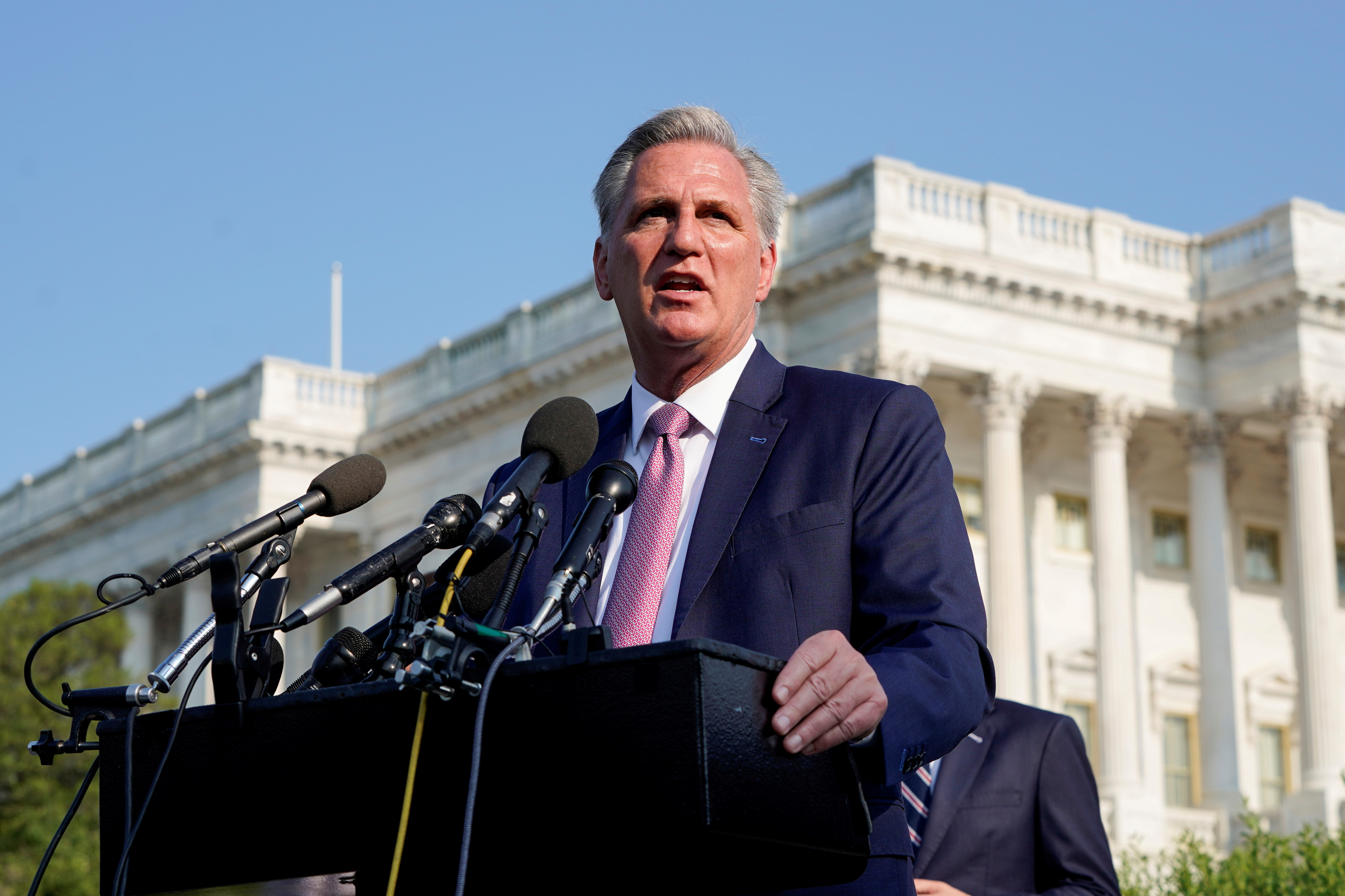 House Minority Leader Kevin McCarthy (R-CA)  speaks to the media with members of the House Republican caucus before the opening hearing of the House (Select) Committee on the Investigation of the January 6th Attack on the U.S. Capitol, on Capitol Hill in Washington, U.S., July 27, 2021.  REUTERS/Joshua Roberts/File Photo