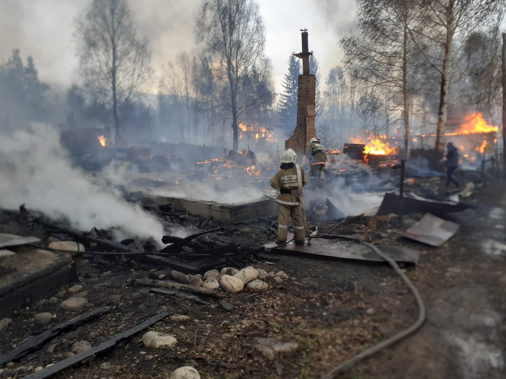 Firefighters work to extinguish a wildfire in the outskirts of Ridder, Kazakhstan, in this image released May 10, 2021. Kazakhstan Department of Emergency Situations of the East Kazakhstan region/Handout via REUTERS