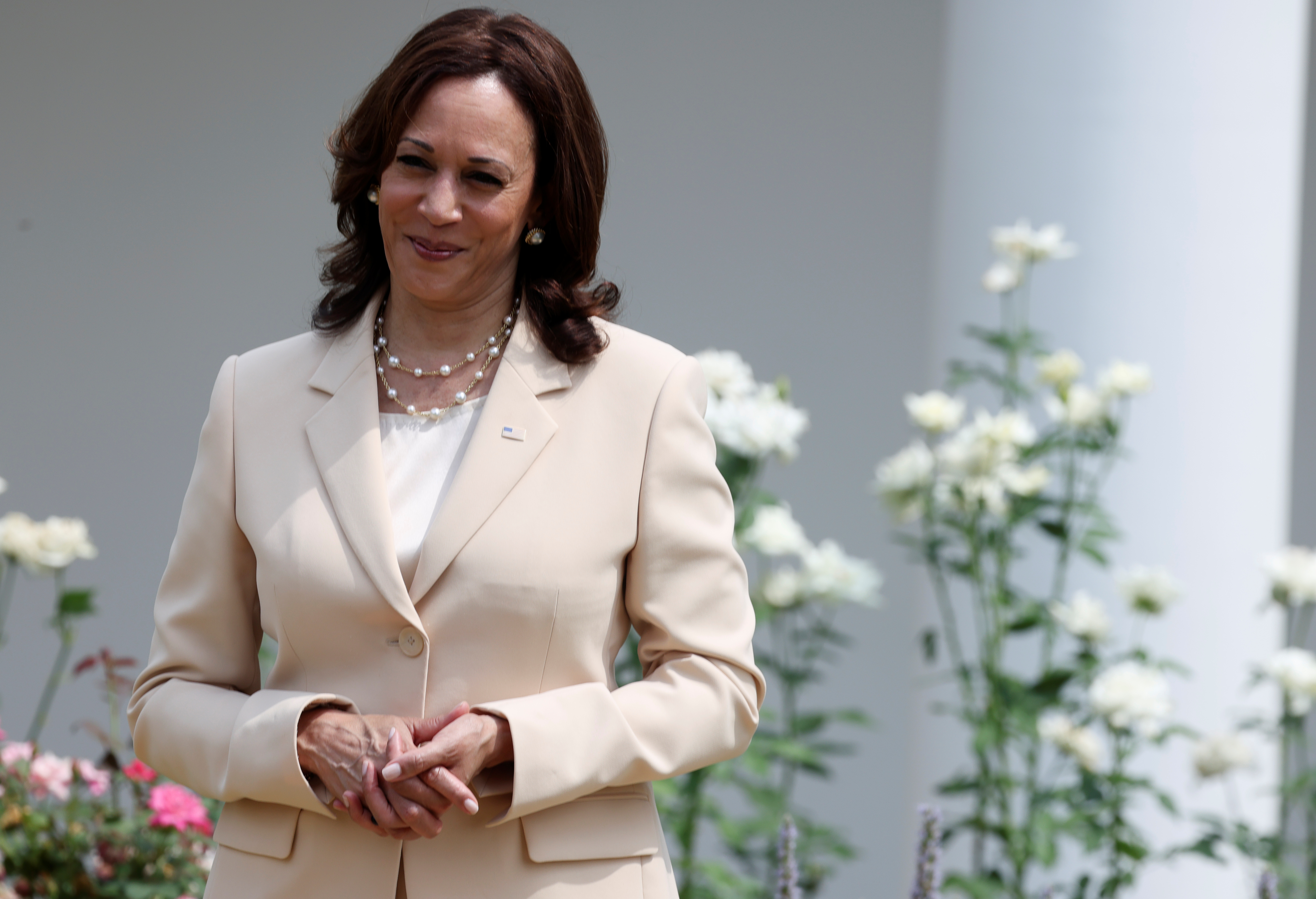 U.S. Vice President Kamala Harris stands by during an event to celebrate the 31st anniversary of the Americans with Disabilities Act (ADA) in the White House Rose Garden in Washington, U.S., July 26, 2021. REUTERS/Evelyn Hockstein