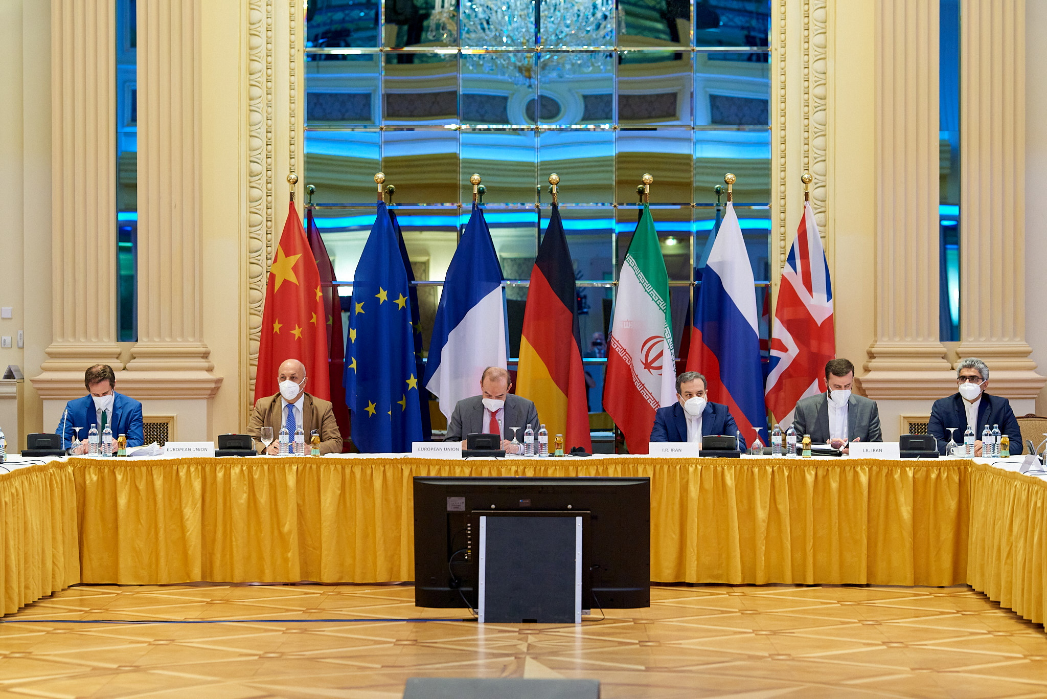 European External Action Service (EEAS) Deputy Secretary General Enrique Mora and Iranian Deputy at Ministry of Foreign Affairs Abbas Araghchi wait for the start of talks on reviving the 2015 Iran nuclear deal in Vienna, Austria June 20, 2021. EU Delegation in Vienna/Handout via REUTERS