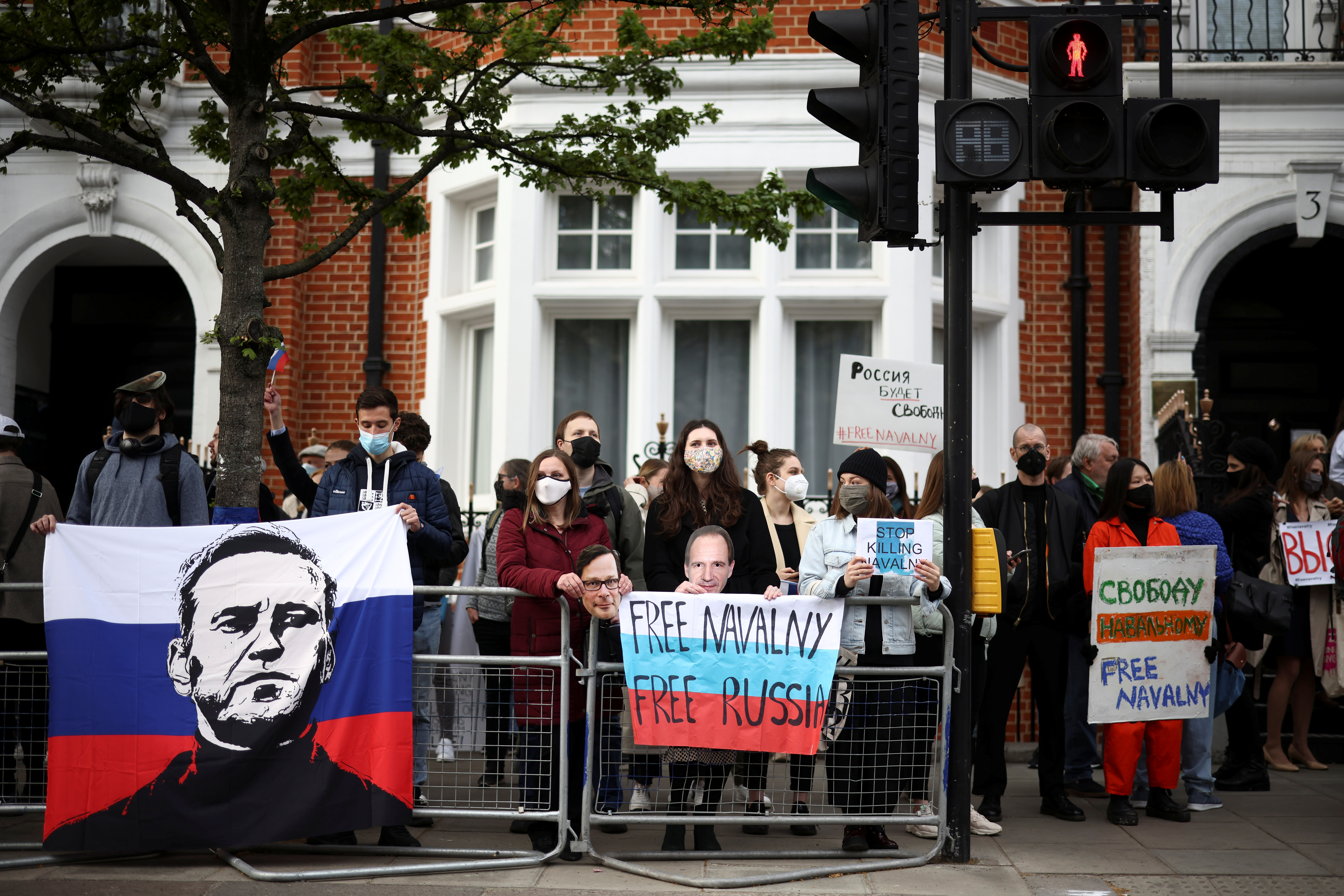 Protesters demonstrate in support of jailed Russian opposition politician Alexei Navalny outside the Russian Embassy in London, Britain, April 21, 2021. REUTERS/Henry Nicholls