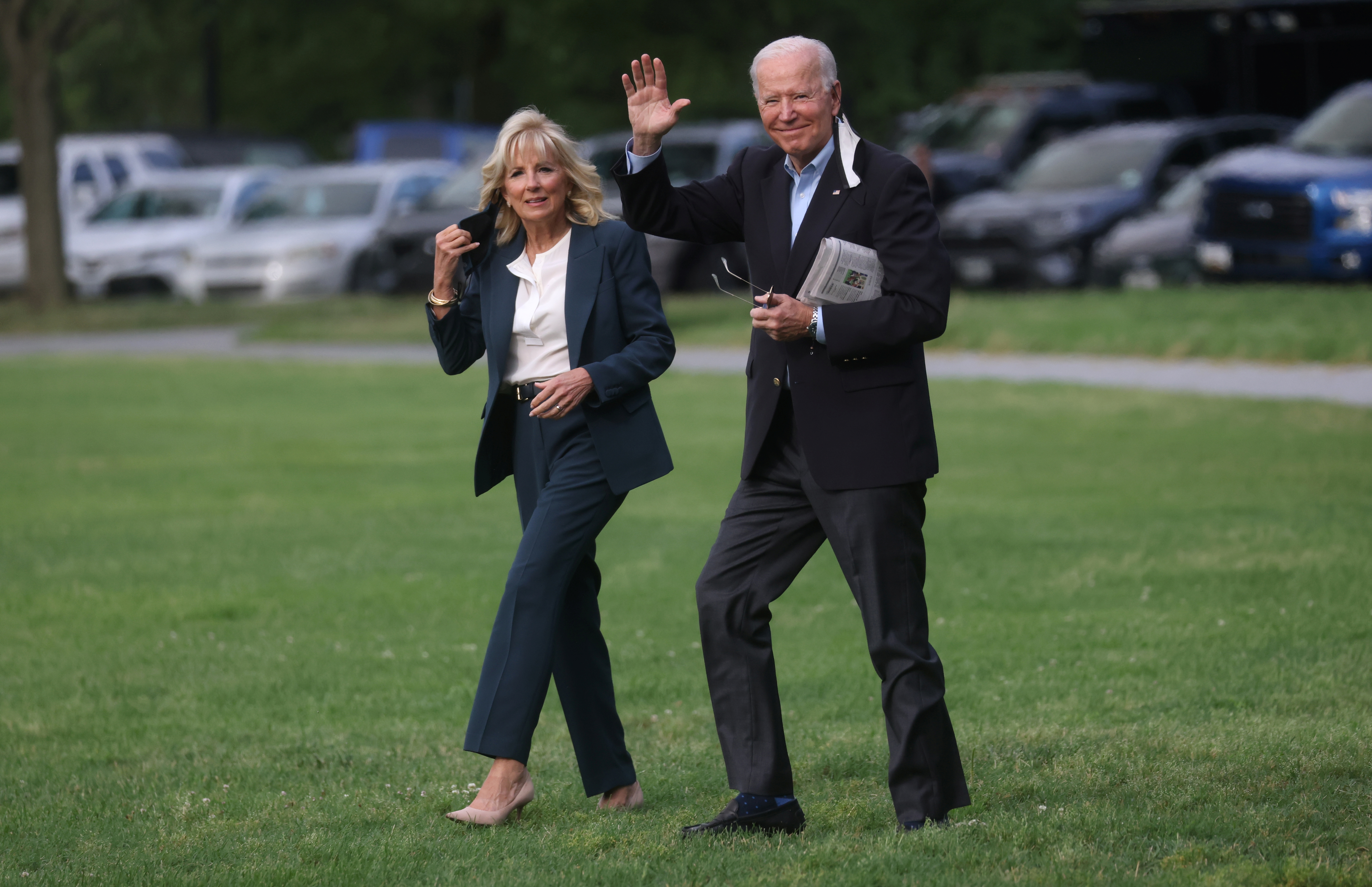 U.S. President Joe Biden and first lady Jill Biden walk to board Marine One for travel to the G7 Summit in the UK from the Ellipse at the White House in Washington, U.S., June 9, 2021. REUTERS/Leah Millis