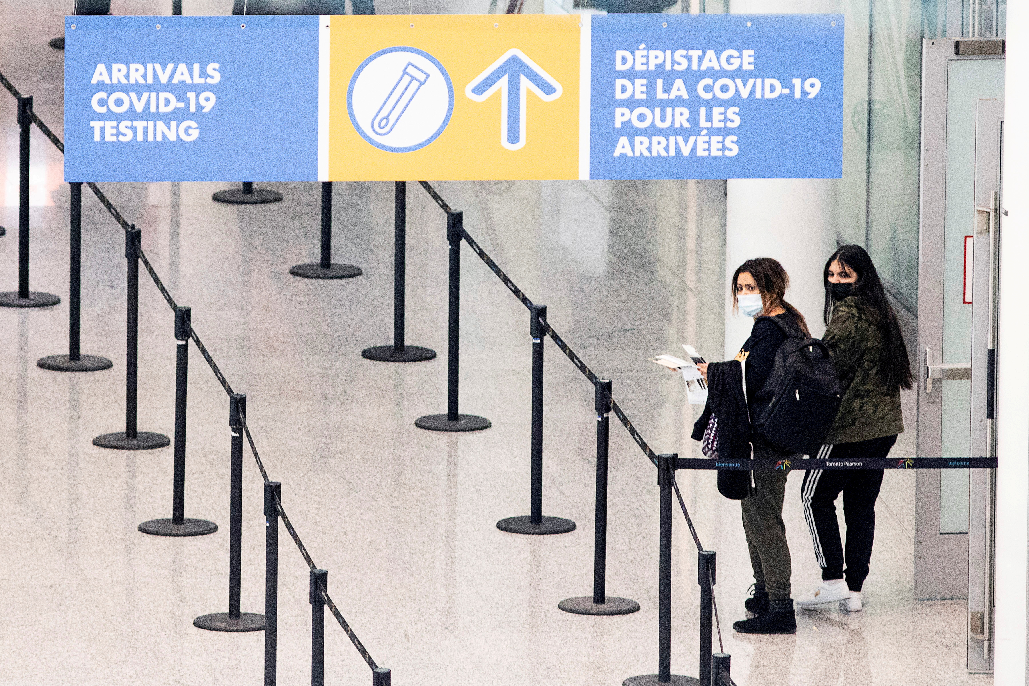 Passengers arrive at Toronto's Pearson airport after mandatory coronavirus disease (COVID-19) testing took effect for international arrivals in Mississauga, Ontario, Canada February 1, 2021. REUTERS/Carlos Osorio