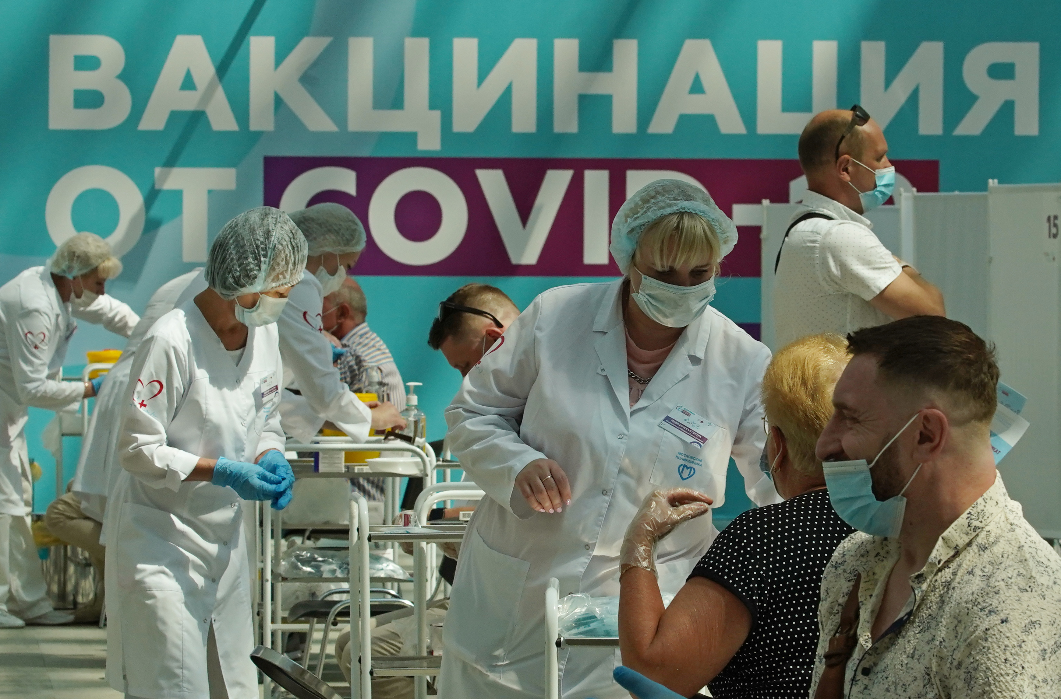 People receive a vaccine against the coronavirus disease (COVID-19) at a vaccination centre in Gostiny Dvor in Moscow, Russia July 6, 2021. REUTERS/Tatyana Makeyeva