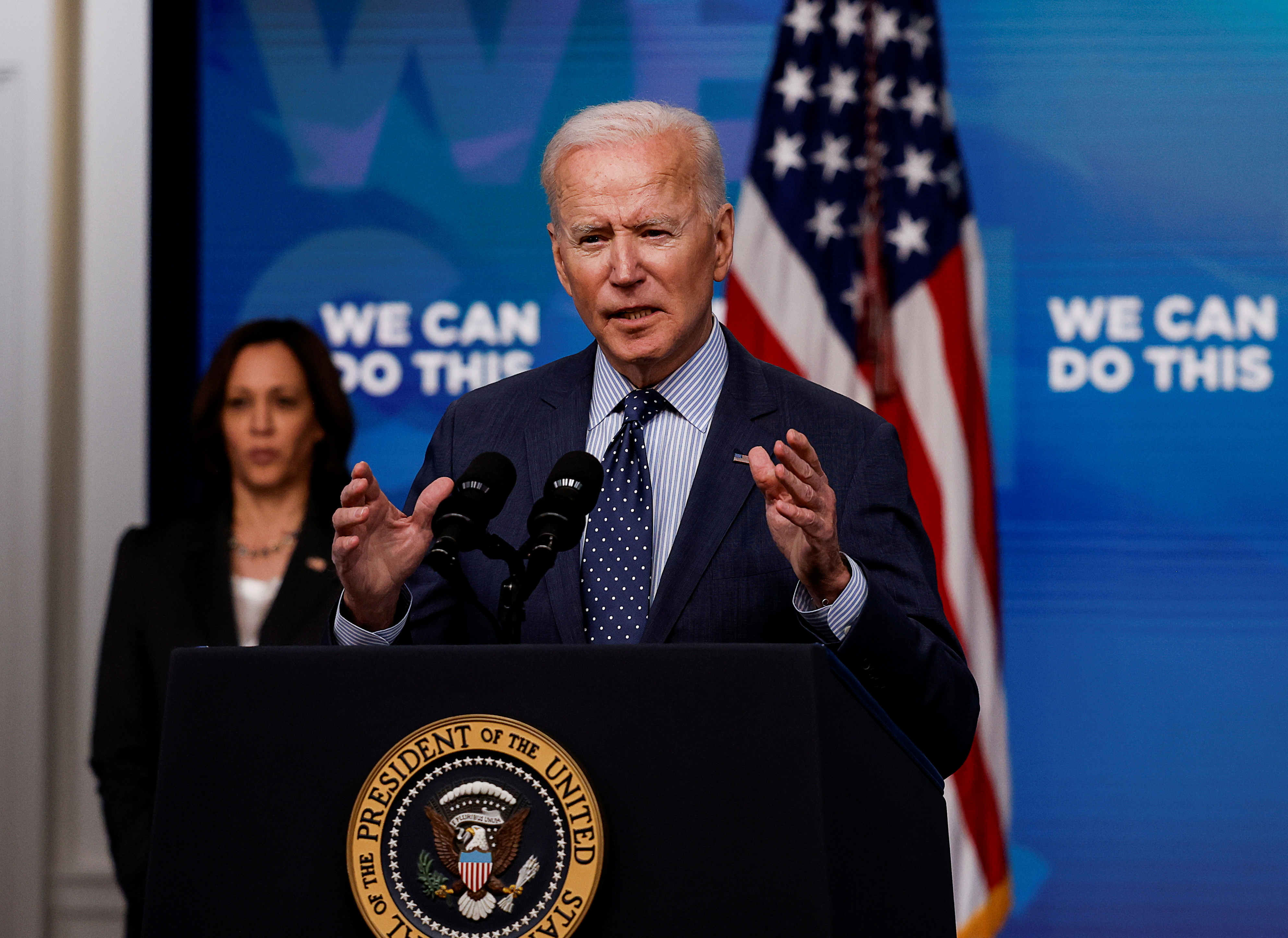 U.S. President Joe Biden delivers remarks on his administration's coronavirus disease (COVID-19) response, as Vice President Kamala Harris stands by in the Eisenhower Executive Office Building's South Court Auditorium at the White House in Washington, U.S., June 2, 2021. REUTERS/Carlos Barria/File Photo
