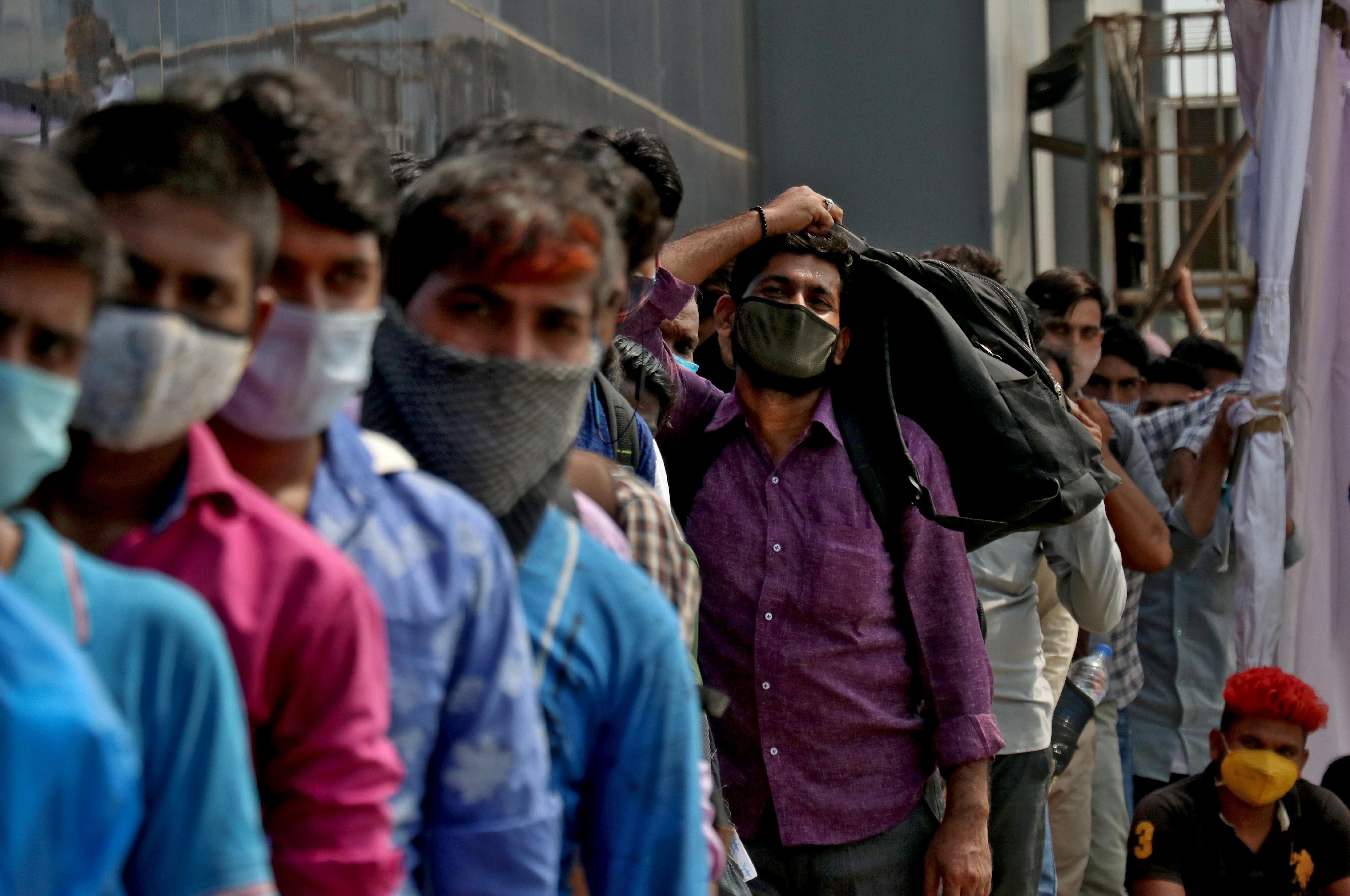 People wait in a line to enter the Lokmanya Tilak Terminus railway station, amid the spread of the coronavirus disease (COVID-19) in Mumbai, India, April 12, 2021. REUTERS/Niharika Kulkarni