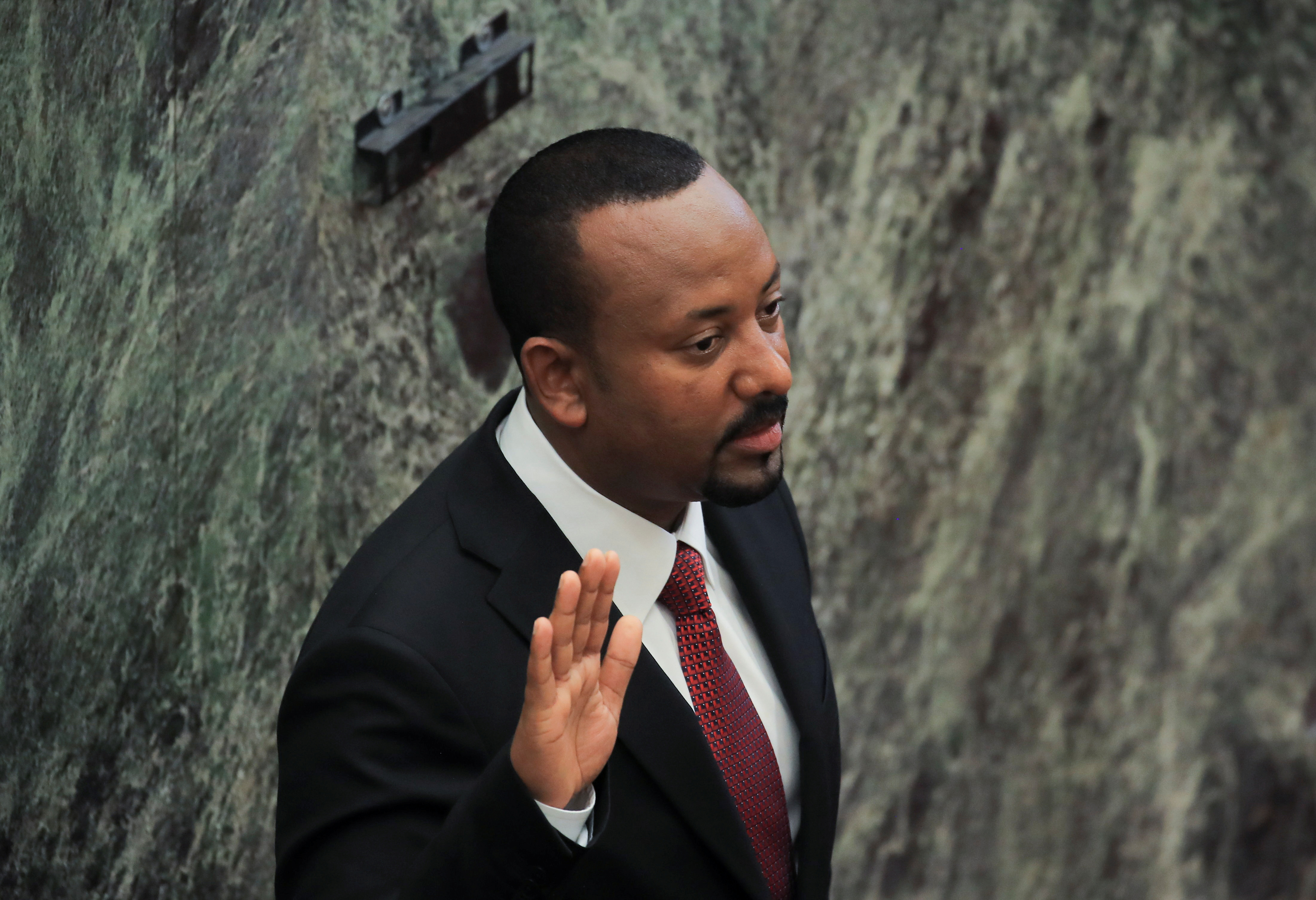 Ethiopia's Prime Minister Abiy Ahmed takes oath during his incumbent ceremony at the Parliament building in Addis Ababa, Ethiopia October 4, 2021. REUTERS/Tiksa Negeri
