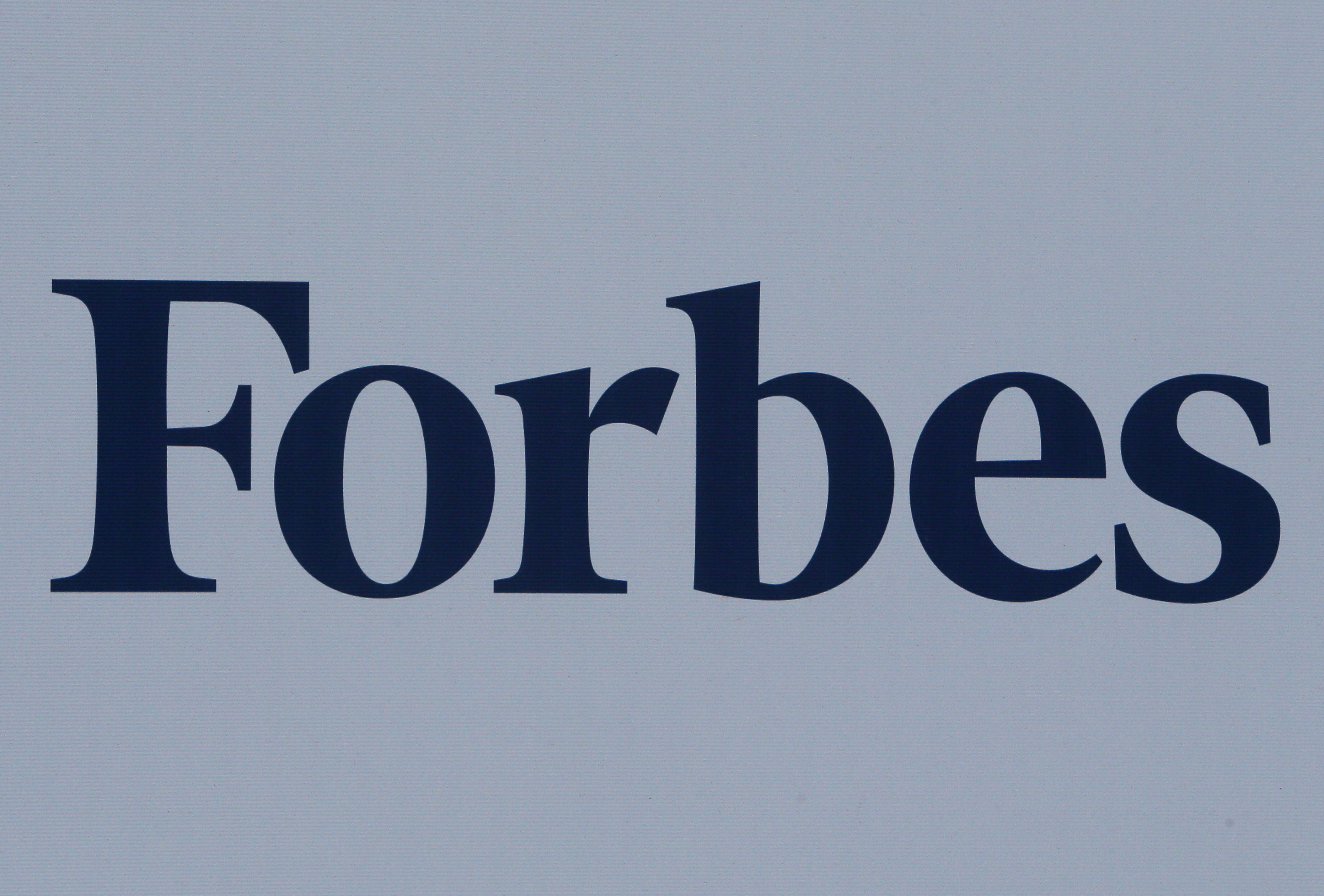 The logo of Forbes magazine is seen on a board at the St. Petersburg International Economic Forum 2017 (SPIEF 2017) in St. Petersburg, Russia, June 1, 2017. REUTERS/Sergei Karpukhin/File Photo