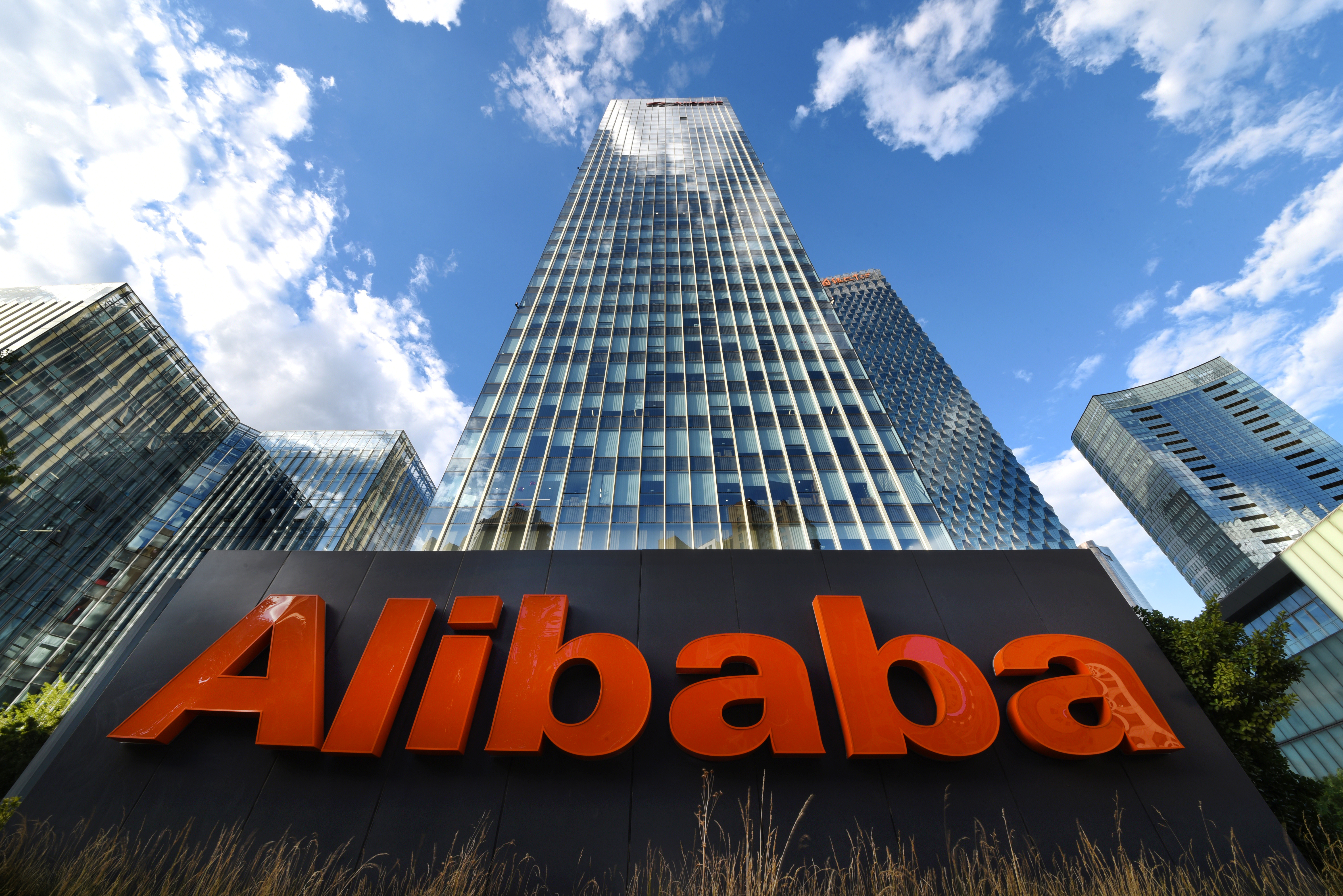 The company sign of Alibaba Group Holding Ltd is seen outside its Beijing headquarters in China June 29, 2019. Picture taken June 29, 2019. REUTERS/Stringer  ATTENTION EDITORS - THIS IMAGE WAS PROVIDED BY A THIRD PARTY. CHINA OUT.
