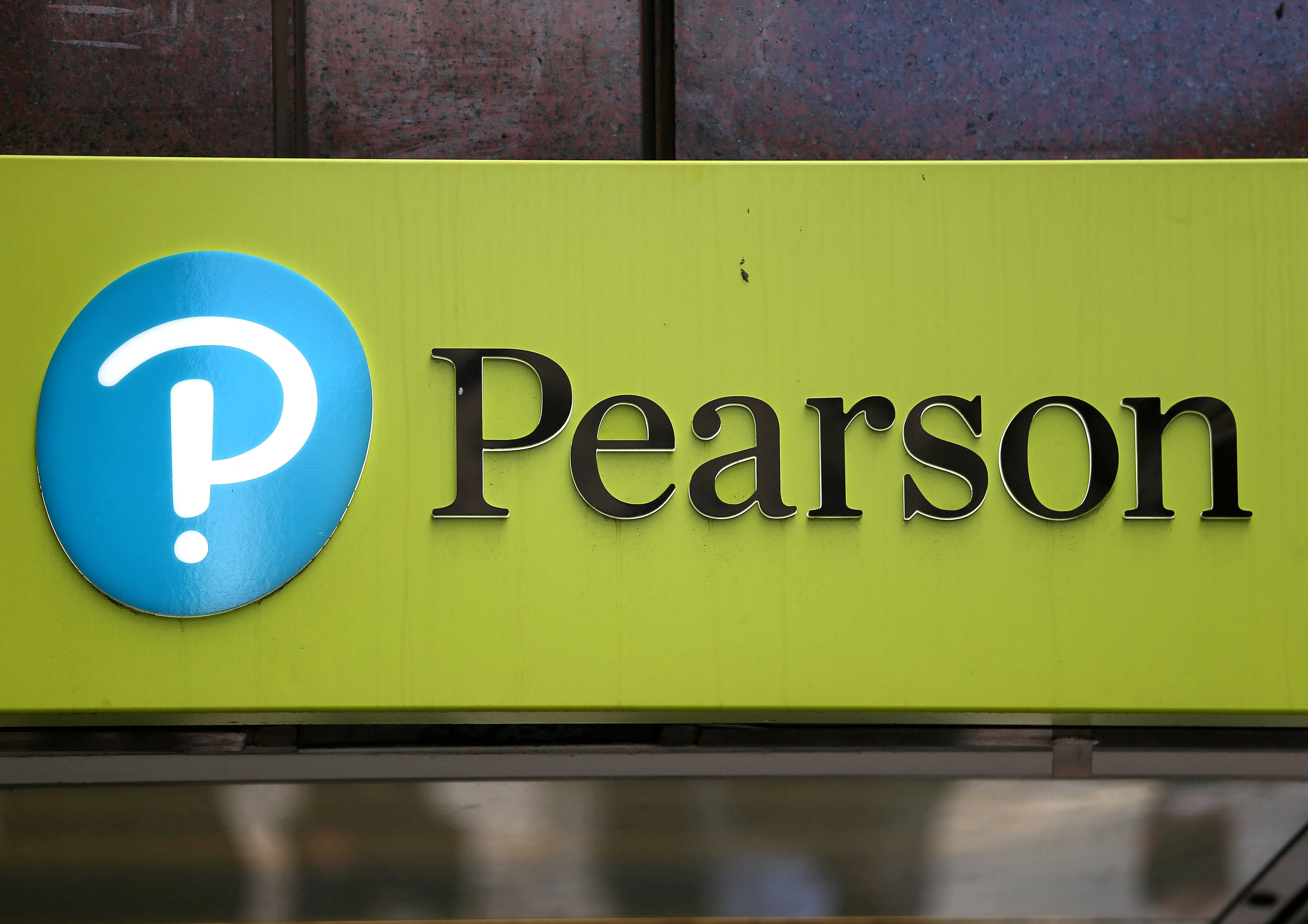The company logo is displayed outside the Pearson offices in London, Britain August 4, 2017. REUTERS/Neil Hall/File Photo