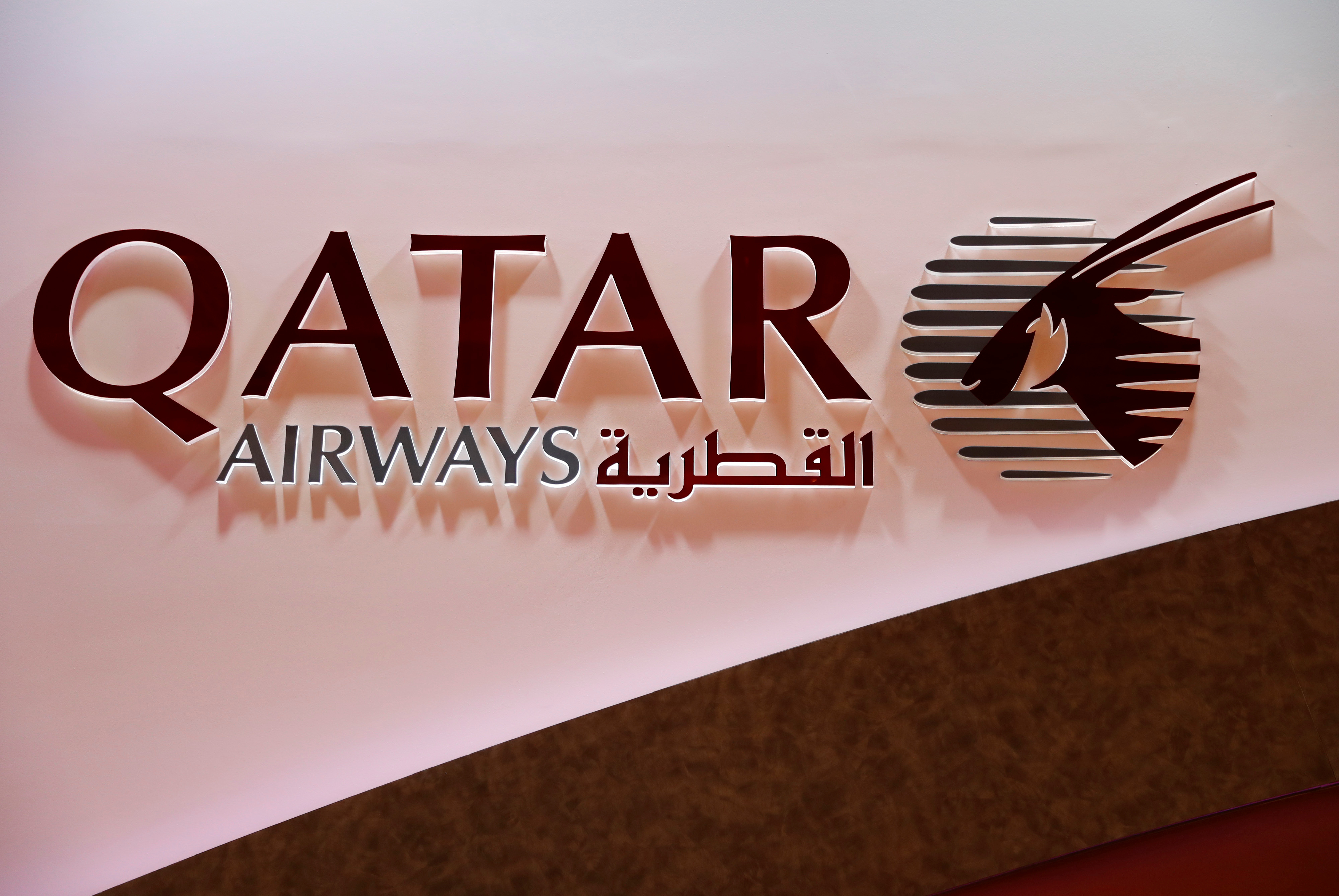 The Qatar Airways logo is pictured at the International Tourism Trade Fair ITB in Berlin, Germany, March 7, 2018./File Photo