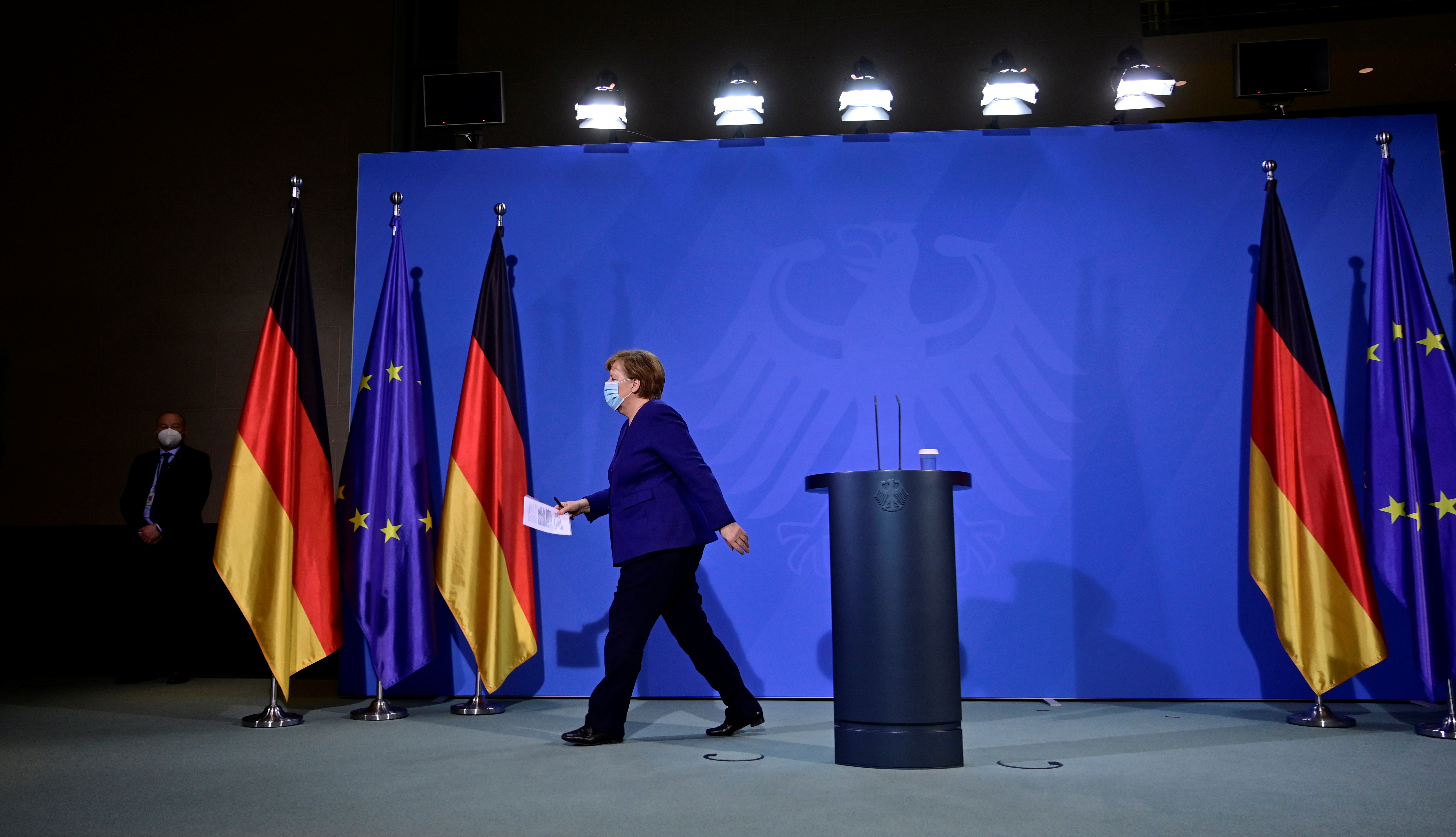 German Chancellor Angela Merkel leaves after addressing a press conference following the EU leaders' videoconference in Berlin, Germany February 25, 2021. John MacDougall/Pool via REUTERS