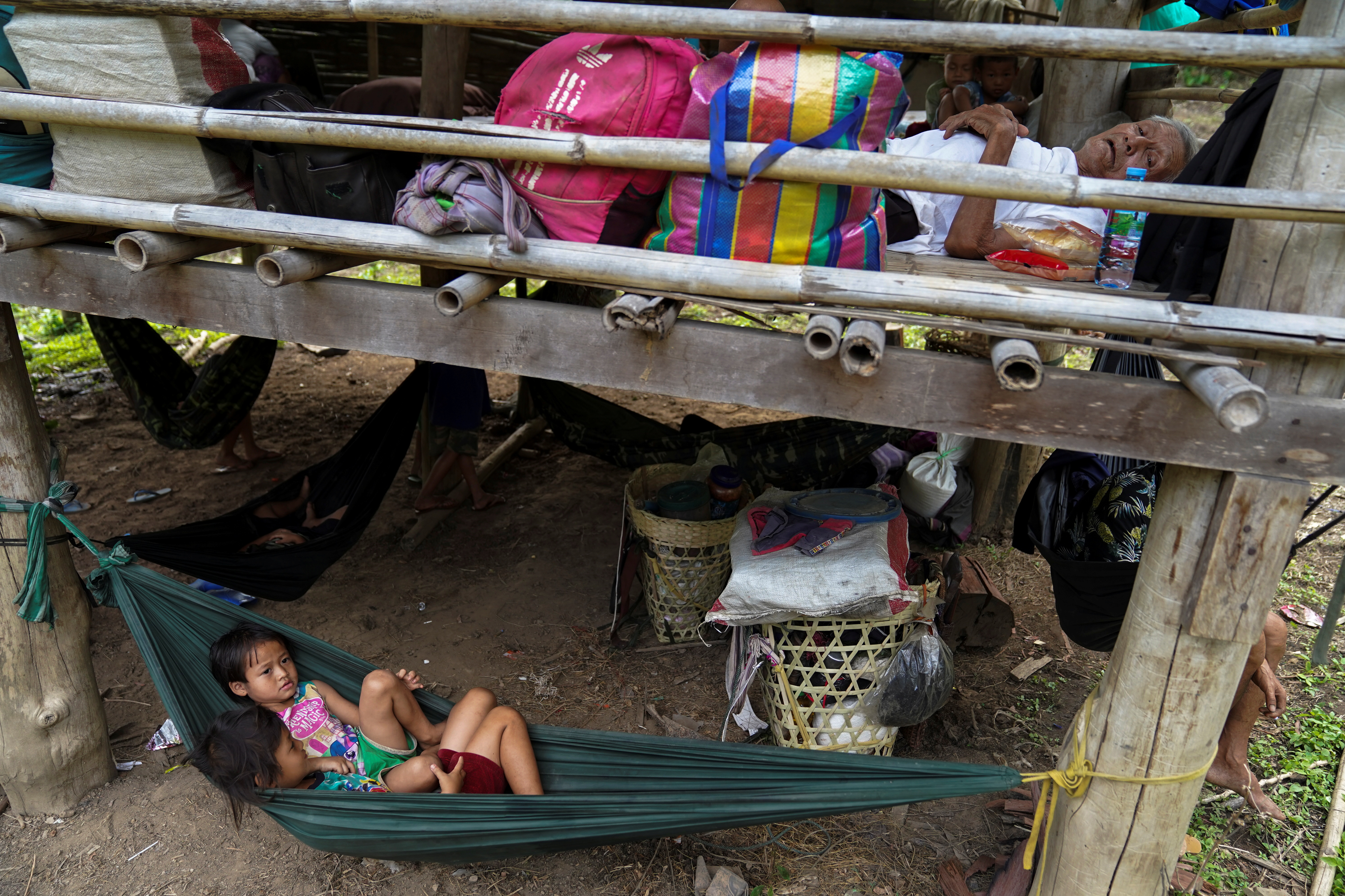Villagers who fled Myanmar's Ee Thu Hta displacement camp rest in Mae Hong Son province, Thailand, near the border while fleeing from gunfire between ethnic minority Karen insurgents and Myanmar military, April 29, 2021. REUTERS/Athit Perawongmetha