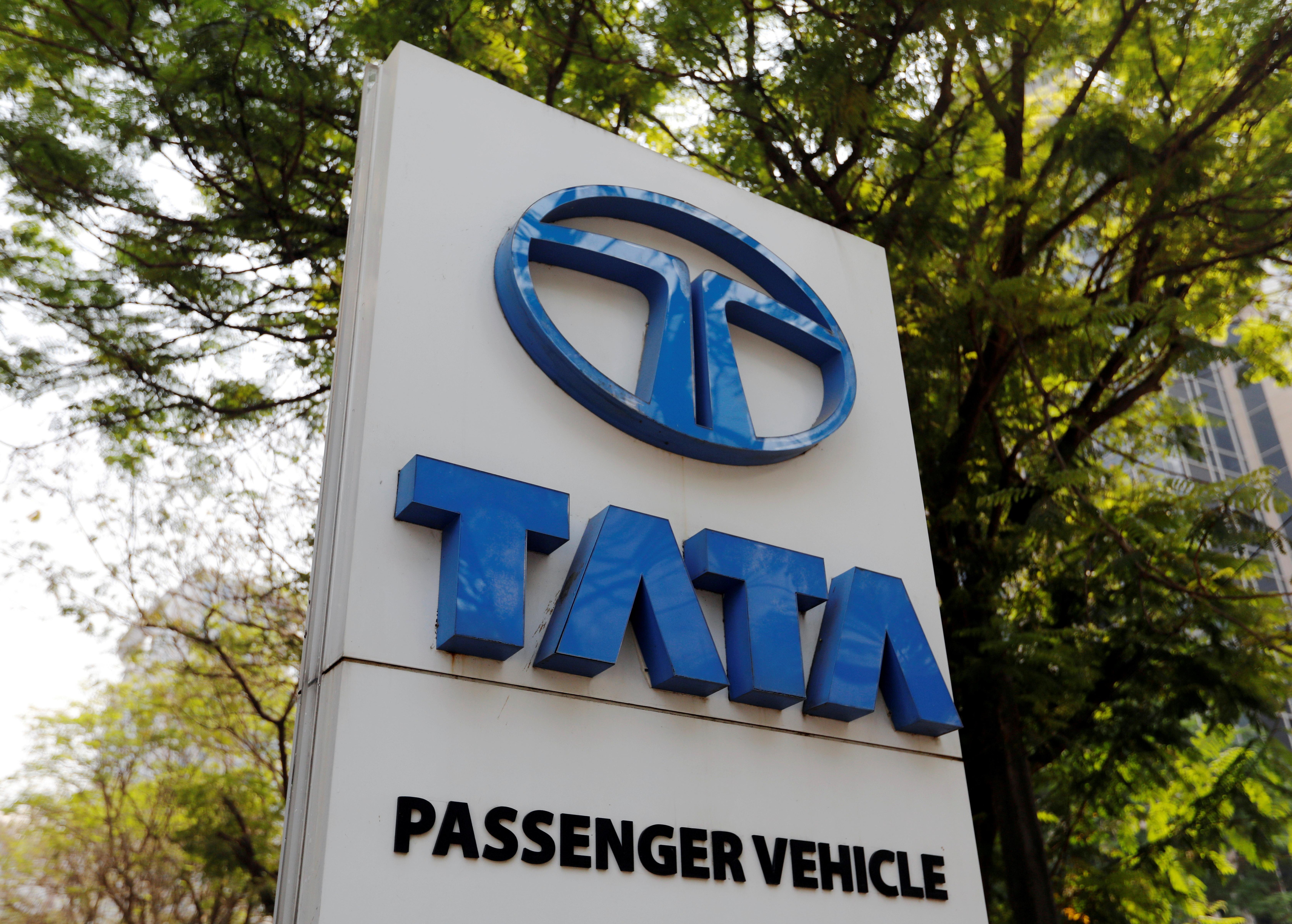 A Tata Motors logo is pictured outside the company showroom in Mumbai, India February 5, 2018. REUTERS/Danish Siddiqui/File Photo