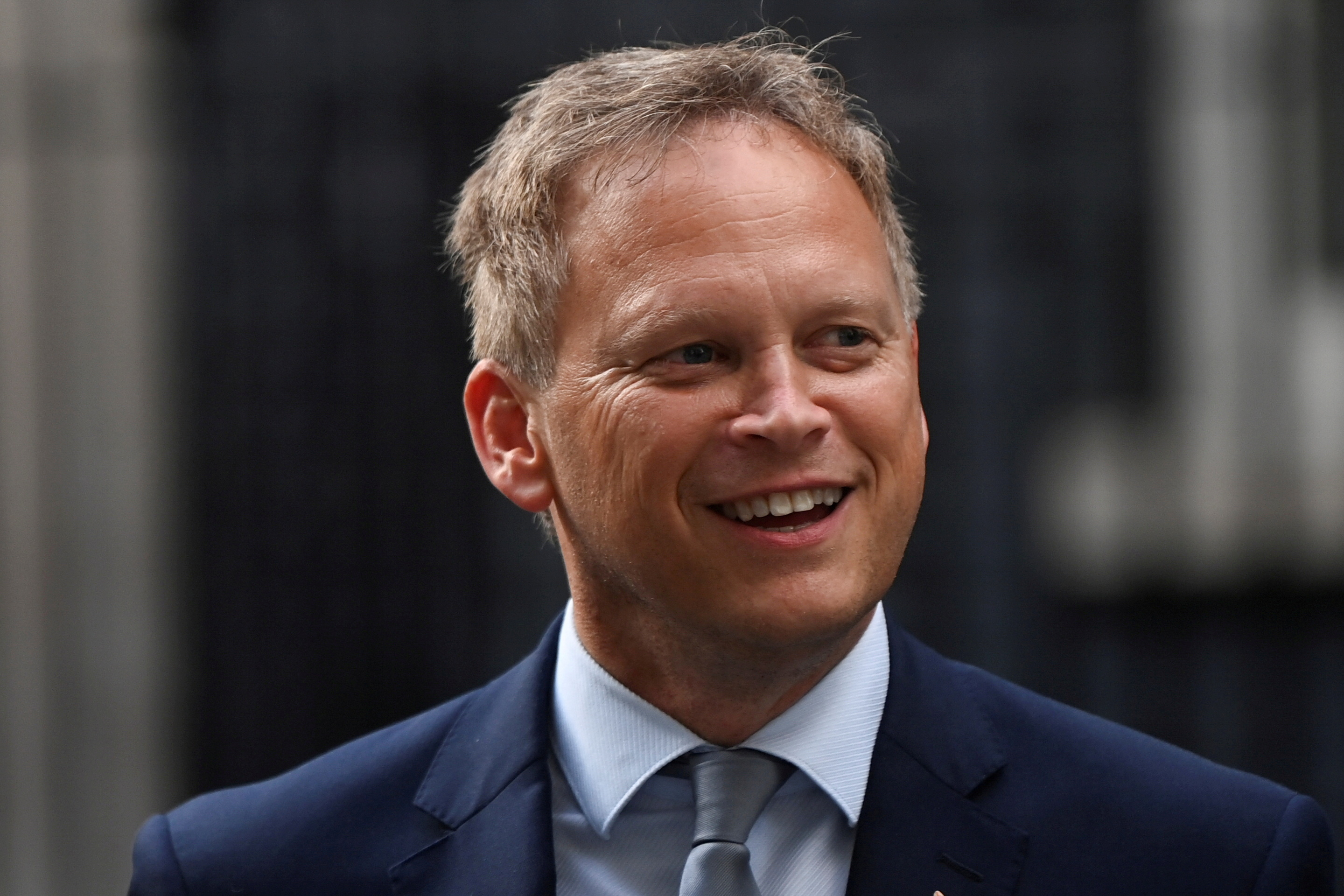 Britain's Transport Secretary Grant Shapps walks outside Downing Street in London, Britain, September 15, 2021. REUTERS/Toby Melville/File Photo
