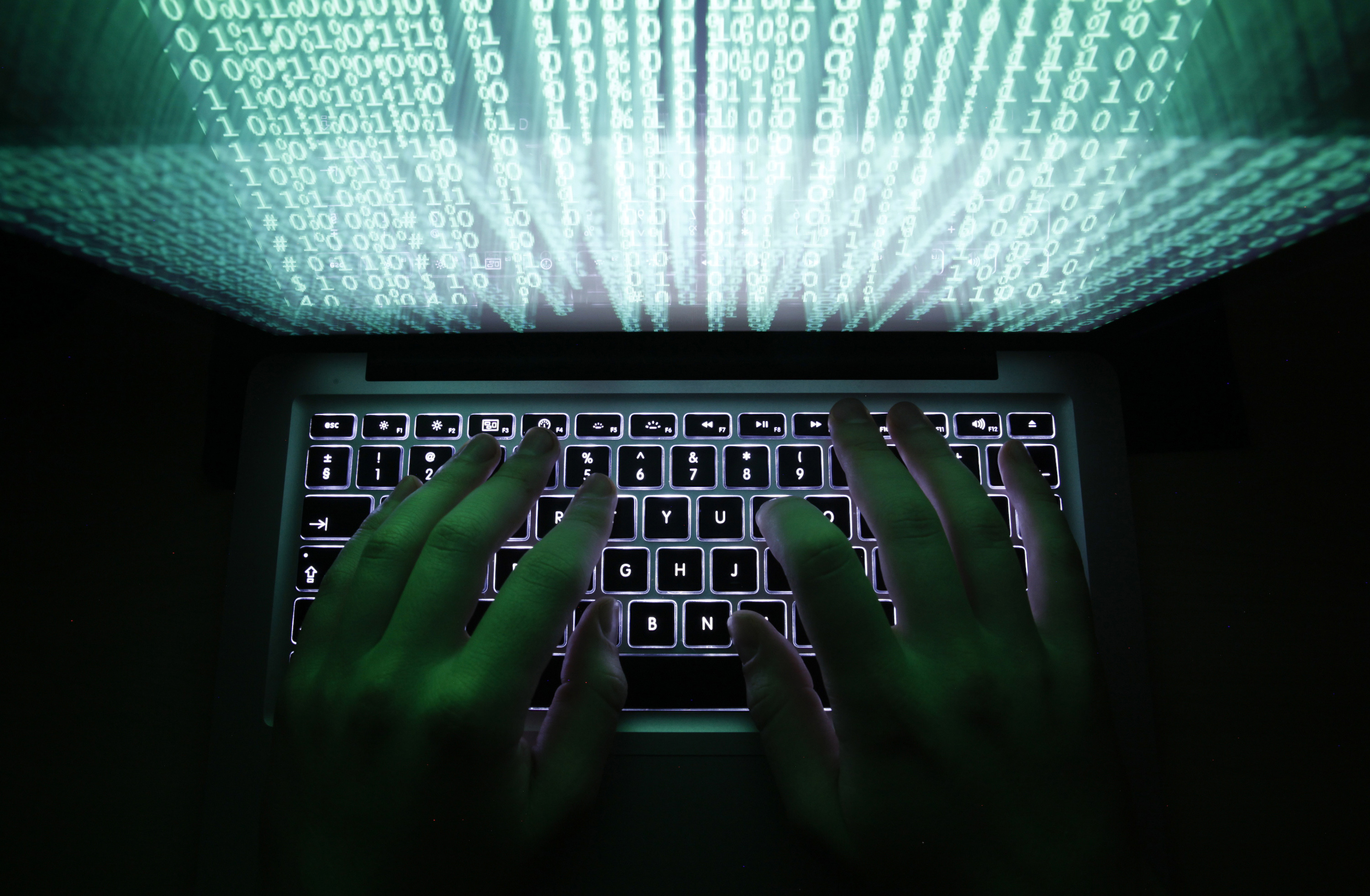 A man types on a computer keyboard in a February 28, 2013 illustration photo. REUTERS/Kacper Pempel