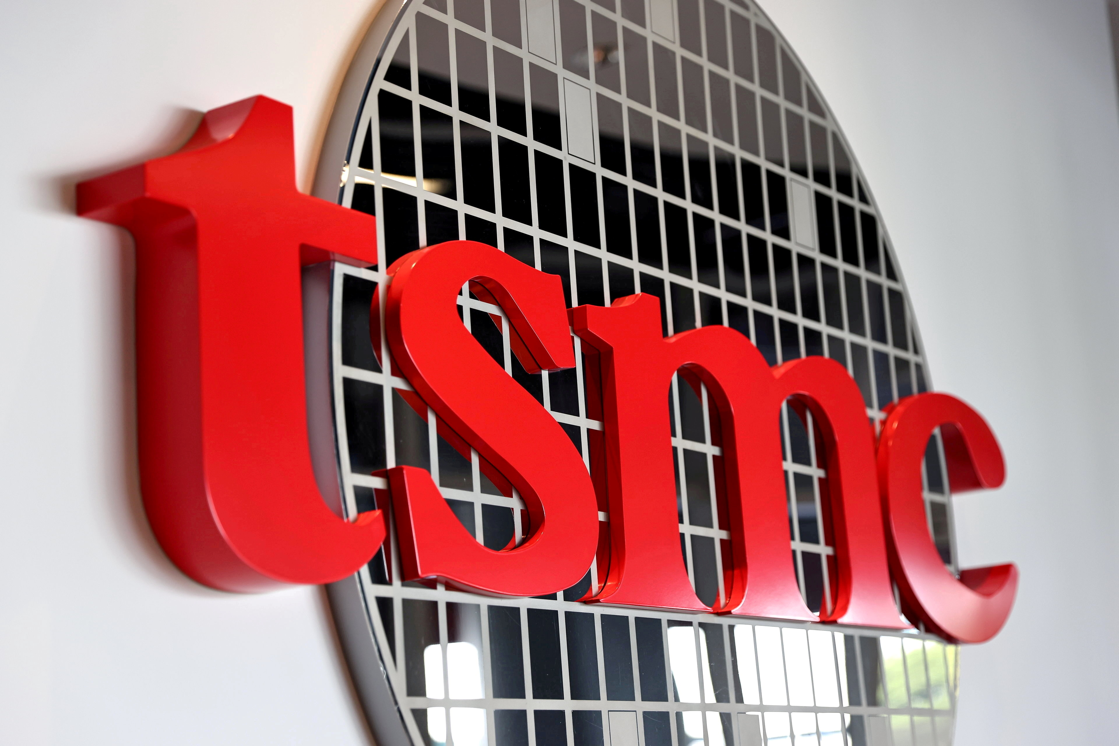 The logo of Taiwan Semiconductor Manufacturing Co (TSMC) is pictured at its headquarters, in Hsinchu, Taiwan, Jan. 19, 2021. REUTERS/Ann Wang