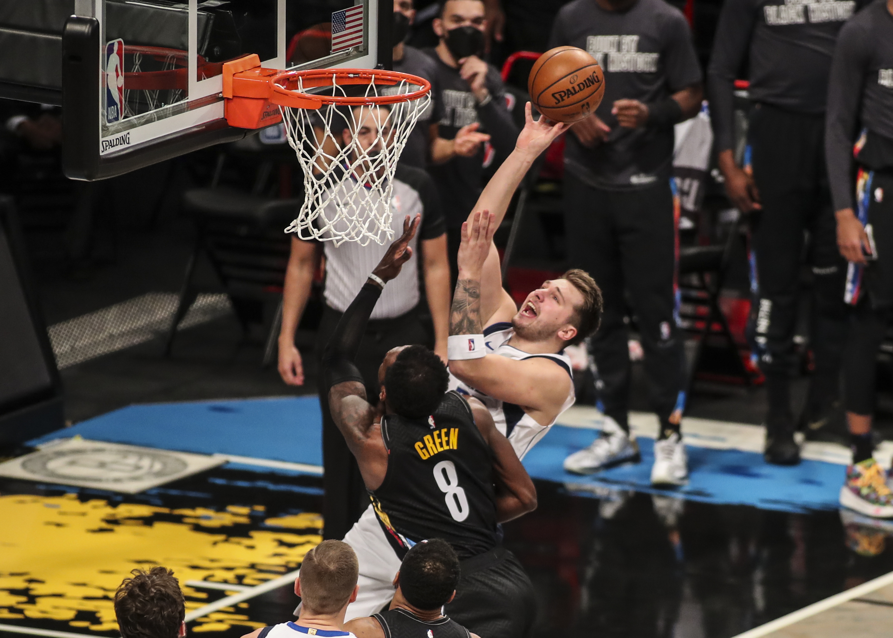 Feb 27, 2021; Brooklyn, New York, USA;  Dallas Mavericks guard Luka Doncic (77) drives to the basket in the third quarter against the Brooklyn Nets at Barclays Center. Mandatory Credit: Wendell Cruz-USA TODAY Sports