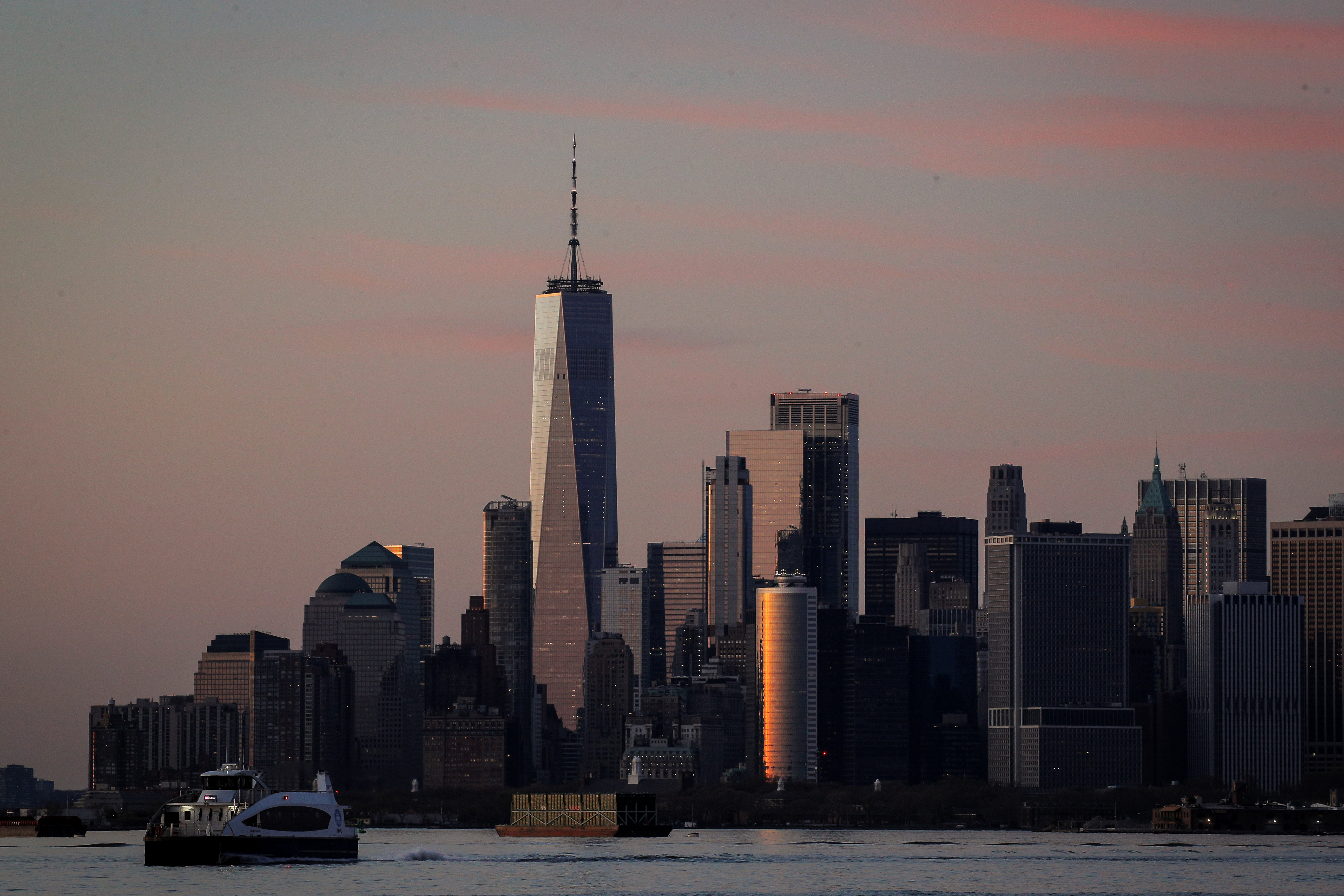 The Manhattan skyline is seen during sunset from the Brooklyn borough of New York City, during the outbreak of the coronavirus disease (COVID-19), U.S.,  April 20, 2020. REUTERS/Brendan McDermid