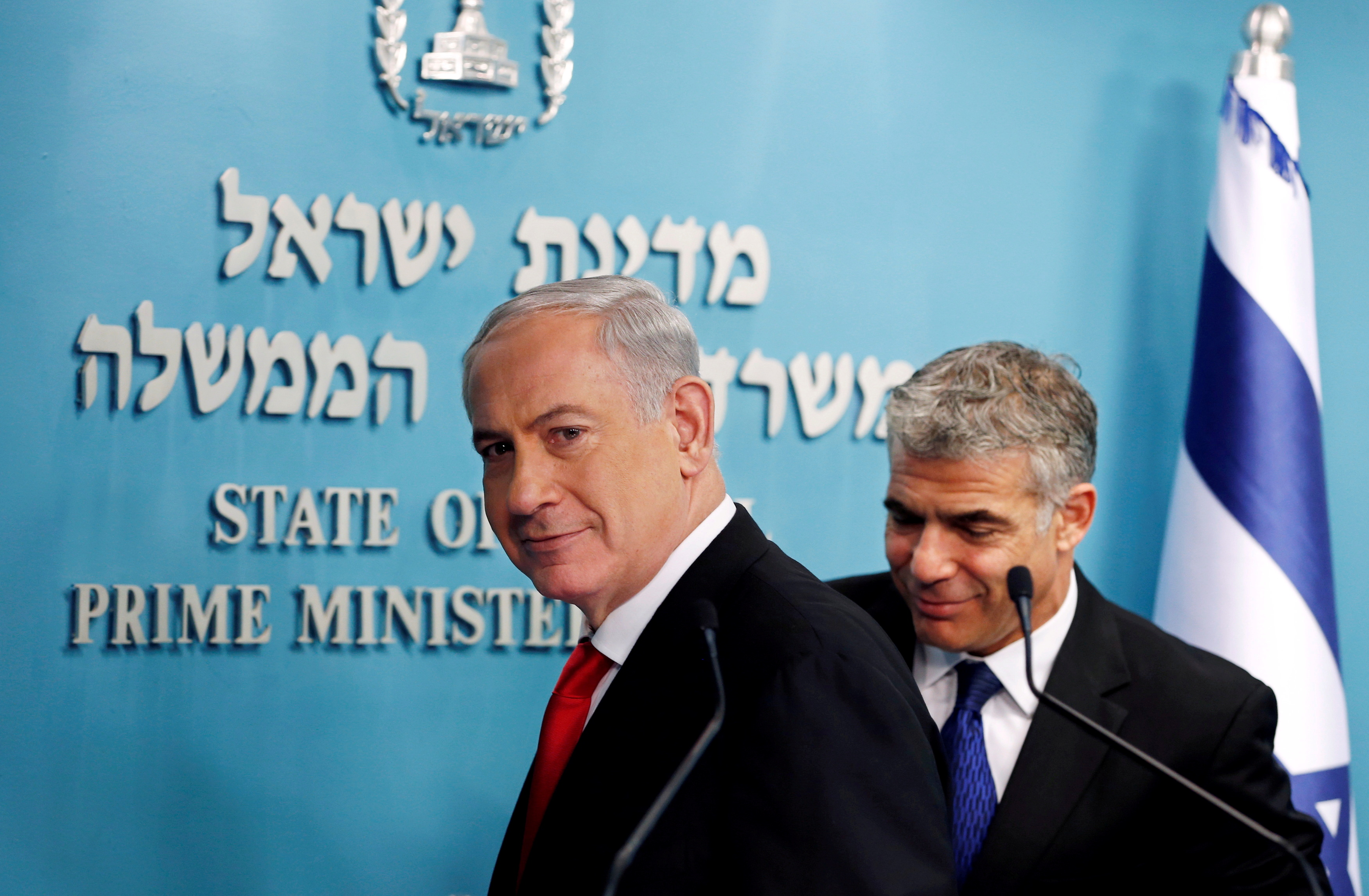 Israeli Prime Minister Benjamin Netanyahu (L) and Finance Minister Yair Lapid leave after a joint news conference in Jerusalem July 3, 2013. REUTERS/Ronen Zvulun/File Photo/File Photo