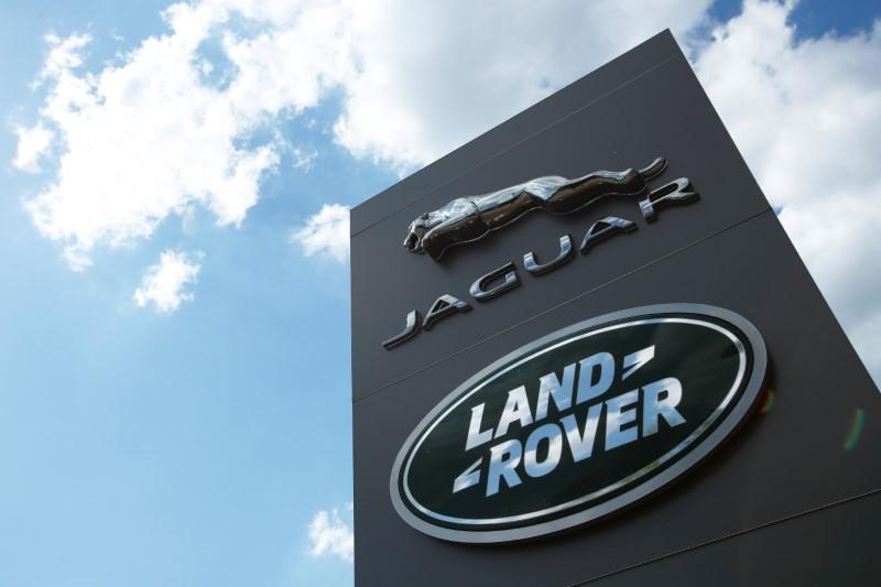 The Jaguar Land Rover logo is seen at a dealership, following the outbreak of the coronavirus disease (COVID-19), Milton Keynes, Britain, June 1, 2020. REUTERS/Andrew Boyers/Files