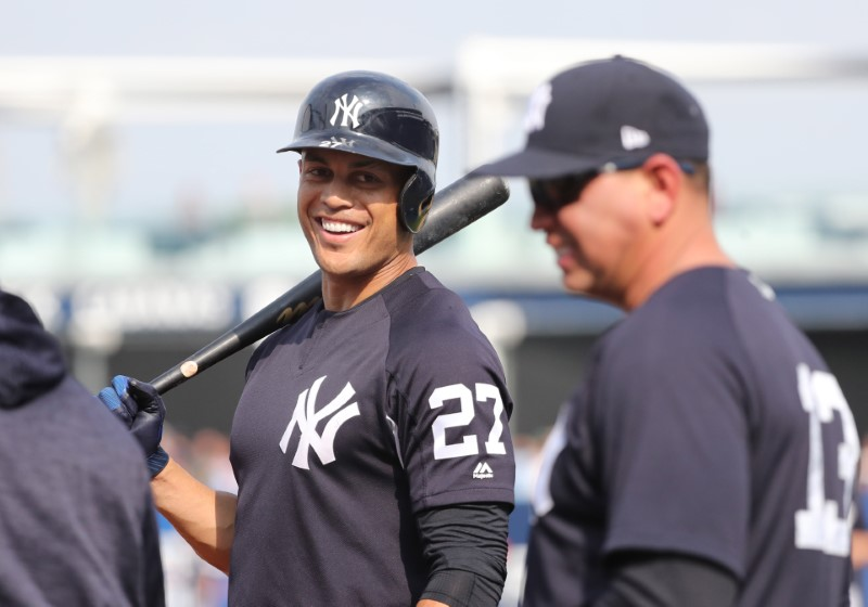 Mar 19, 2018; Tampa, FL, USA; New York Yankees designated hitter Giancarlo Stanton (27) shares a laugh with Alex Rodriguez (13), Mandatory Credit: Kim Klement-USA TODAY Sports