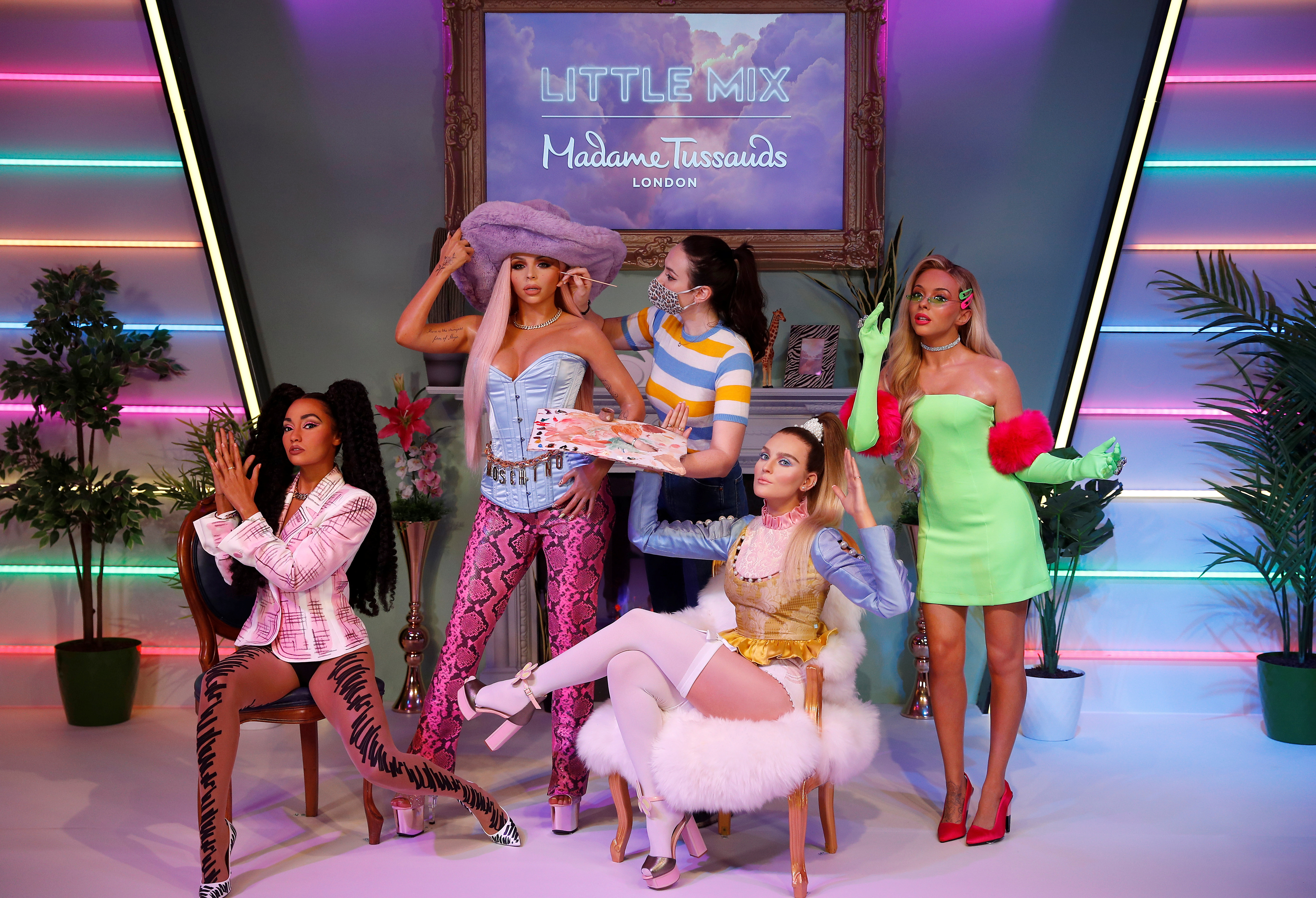 A waxworks artist retouches one of the wax figures at the unveiling of Little Mix waxwork figures at Madame Tussauds, in London, Britain, July 28, 2021.  REUTERS/Peter Nicholls