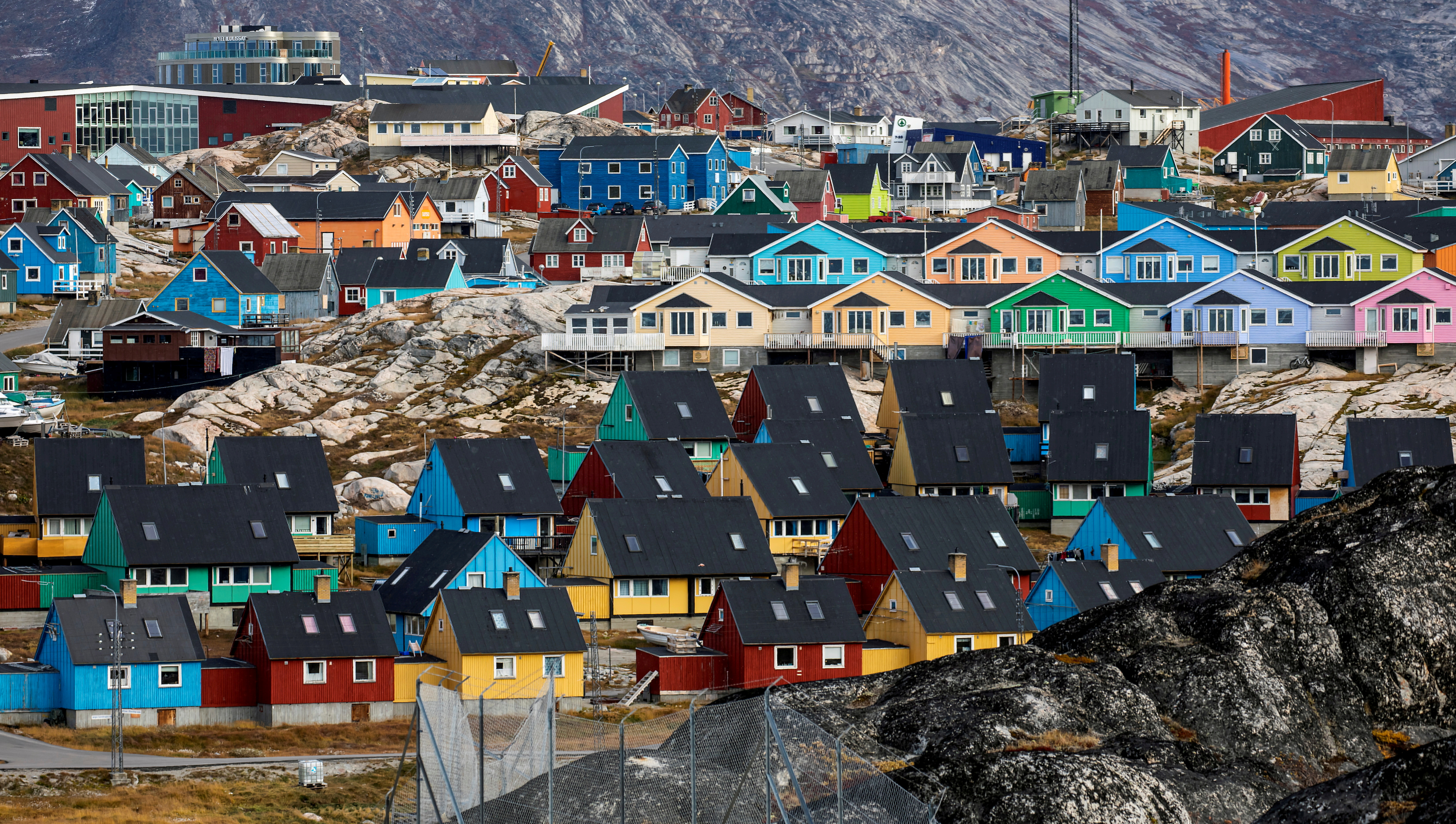 Houses are pictured in Ilulissat, Greenland, September 14, 2021.  REUTERS/Hannibal Hanschke