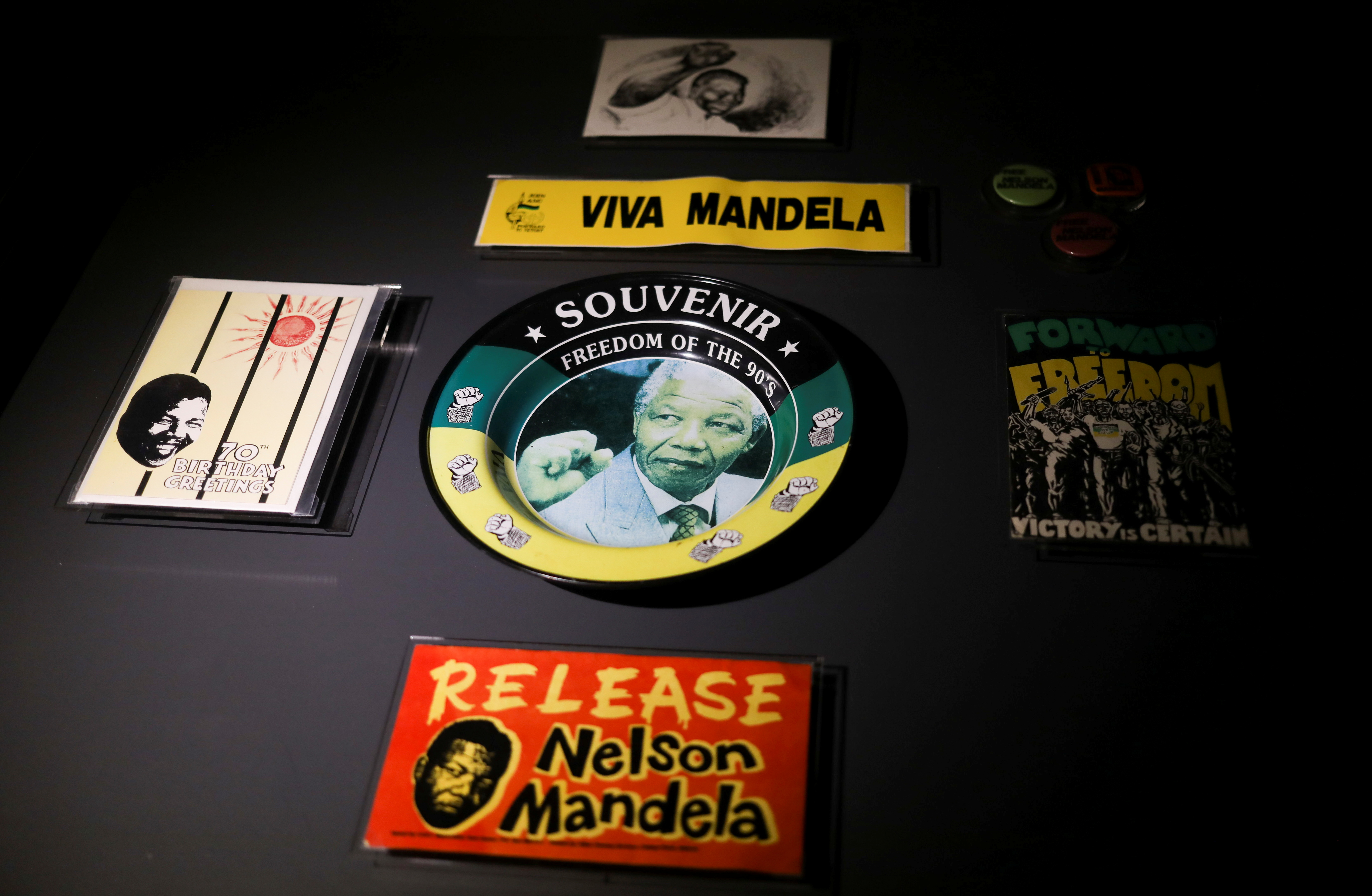 Memorabilia with the face of former South African President Nelson Mandela, are displayed at the Apartheid Museum, one of dozens of heritage attractions and art galleries around the country forced to close their doors due to the coronavirus disease (COVID-19) pandemic, in Johannesburg , South Africa, April 7, 2021. REUTERS/Siphiwe Sibeko